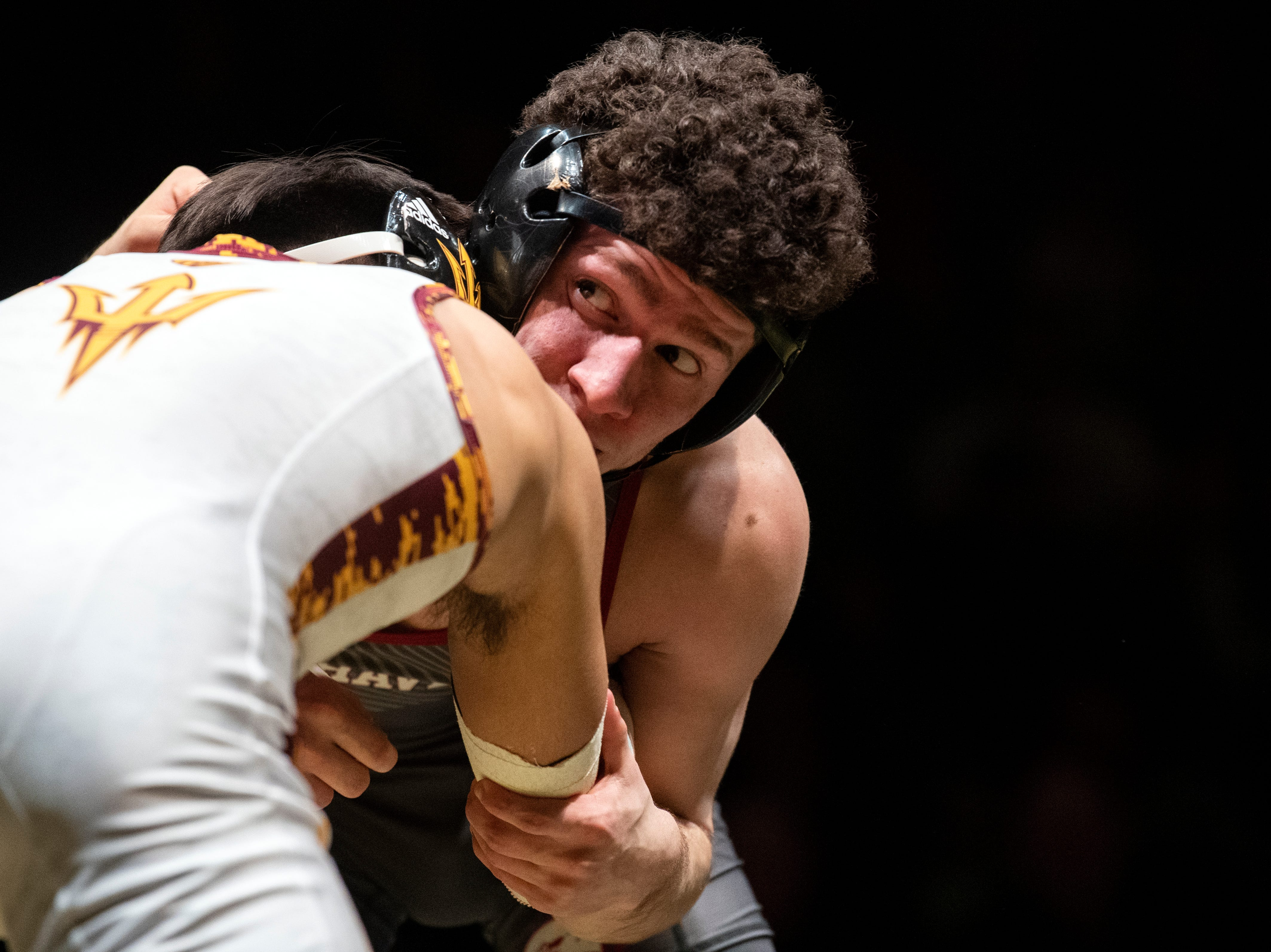 Lock Haven's Luke Werner looks at the ref while wrestling Arizona State's Brandon Courtney during the 125-pound bout at Red Lion's Fitzkee Athletic Center on Friday, Jan. 25, 2019. Werner pinned Courtney as No. 22 Lock Haven upset No. 12 Arizona State, 23-14, in the first ever 'Rumble in the Jungle.'