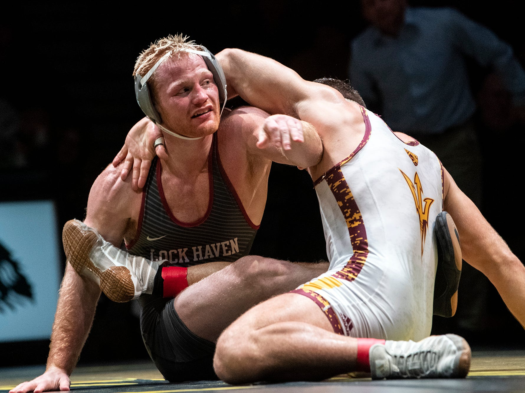 Lock Haven's Chance Marsteller, left, tries to escape Arizona State's Josh Shields during the 165-pound bout at Red Lion's Fitzkee Athletic Center on Friday, Jan. 25, 2019. Shields (No. 5) beat Marsteller (No. 4), 2-1, in a tiebreaker. No. 22 Lock Haven upset No. 12 Arizona State, 23-14, in the first ever 'Rumble in the Jungle.'