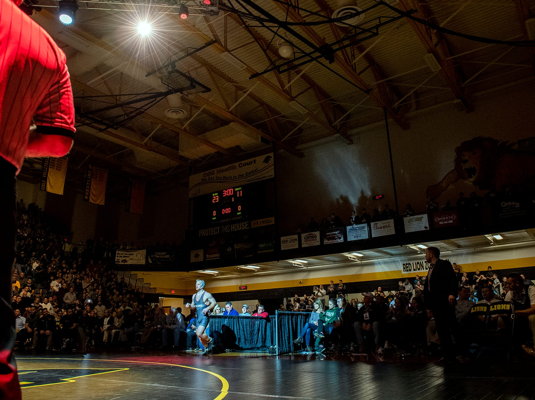 Lock Haven wrestler and Kennard-Dale grad Chance Marsteller (No. 4) trots onto the mat for his 165-pound match against Arizona State's Josh Shields (No. 5) at Red Lion's Fitzkee Athletic Center on Friday, Jan. 25, 2019. Shields beat Marsteller, 2-1, in a tiebreaker. No. 22 Lock Haven upset No. 12 Arizona State, 23-14, in the first ever 'Rumble in the Jungle.'