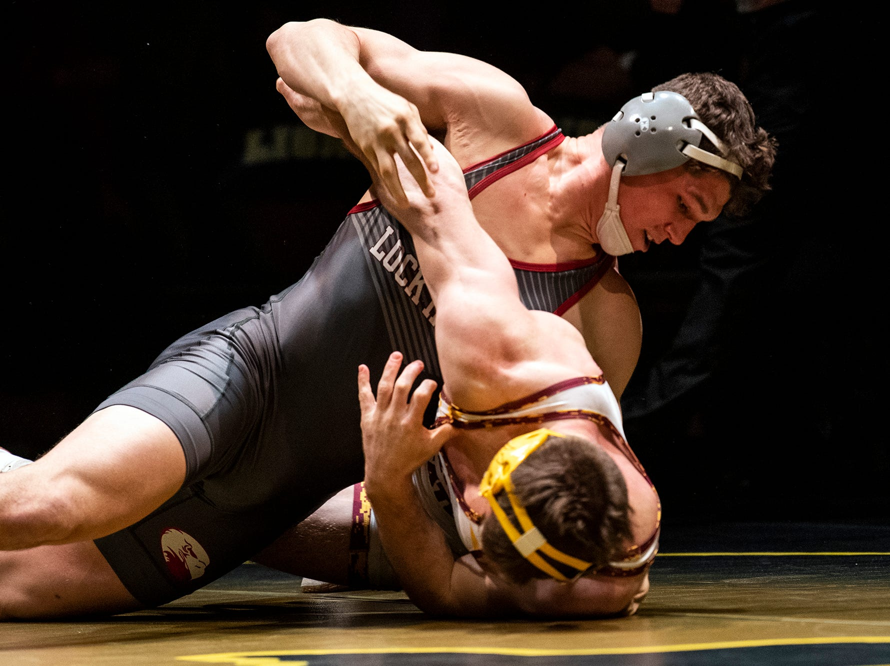 Lock Haven's Parker McClellan, top, works to turn Arizona State's Austyn Harris to his back during the 197-pound bout at Red Lion's Fitzkee Athletic Center on Friday, Jan. 25, 2019. McClellan beat Harris, 2-1, as No. 22 Lock Haven upset No. 12 Arizona State, 23-14, in the first ever 'Rumble in the Jungle.'