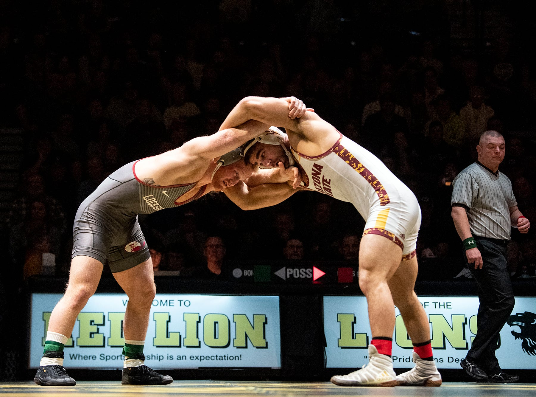 Lock Haven's Chance Marsteller, left, wrestles with Arizona State's Josh Shields during the 165-pound bout at Red Lion's Fitzkee Athletic Center on Friday, Jan. 25, 2019. Shields (No. 5) beat Marsteller (No. 4), 2-1, in a tiebreaker. No. 22 Lock Haven upset No. 12 Arizona State, 23-14, in the first ever 'Rumble in the Jungle.'