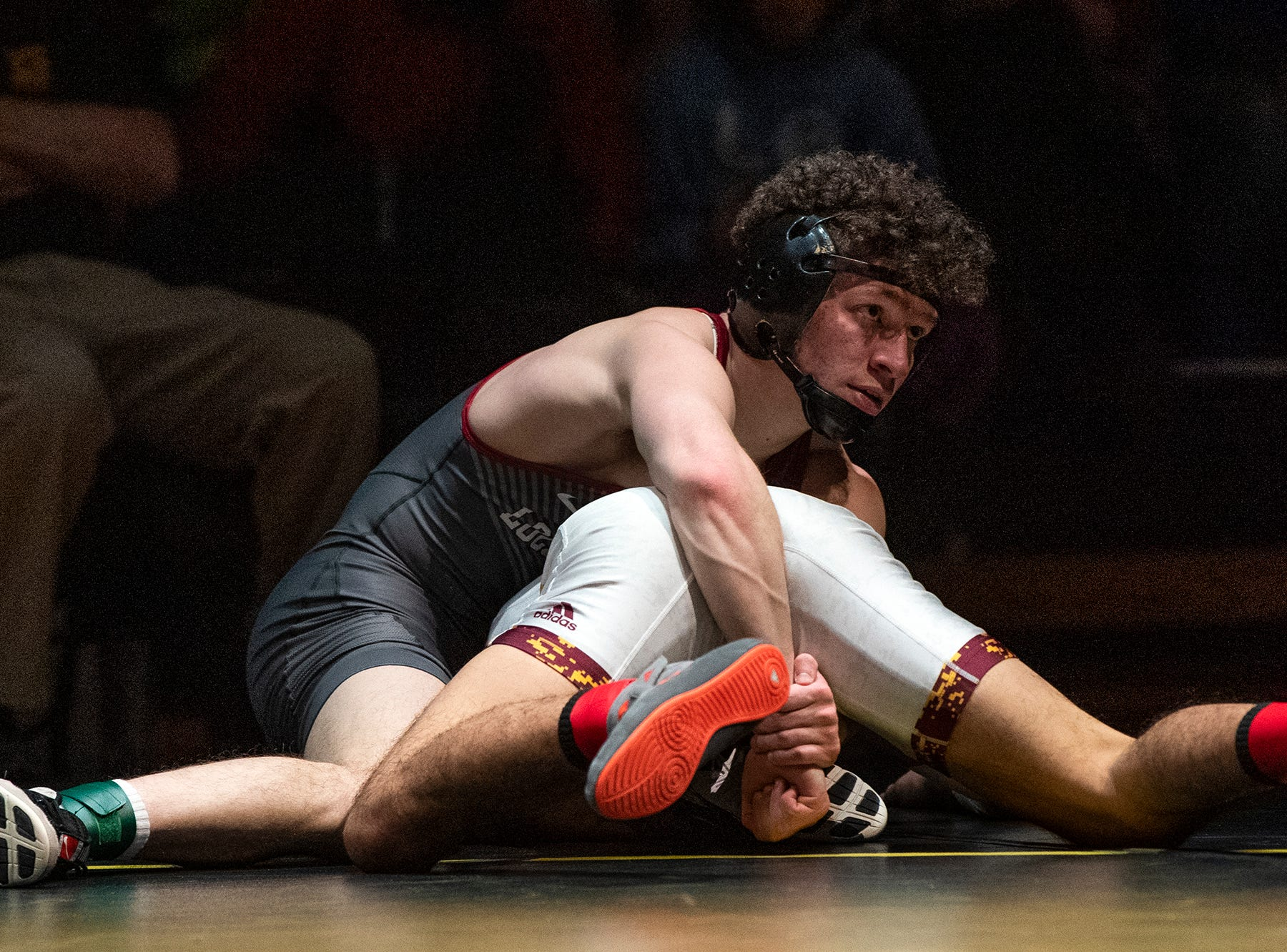 Lock Haven's Luke Werner top, looks toward his coach while wrestling Arizona State's Brandon Courtney during the 125-pound bout at Red Lion's Fitzkee Athletic Center on Friday, Jan. 25, 2019. Werner pinned Courtney as No. 22 Lock Haven upset No. 12 Arizona State, 23-14, in the first ever 'Rumble in the Jungle.'