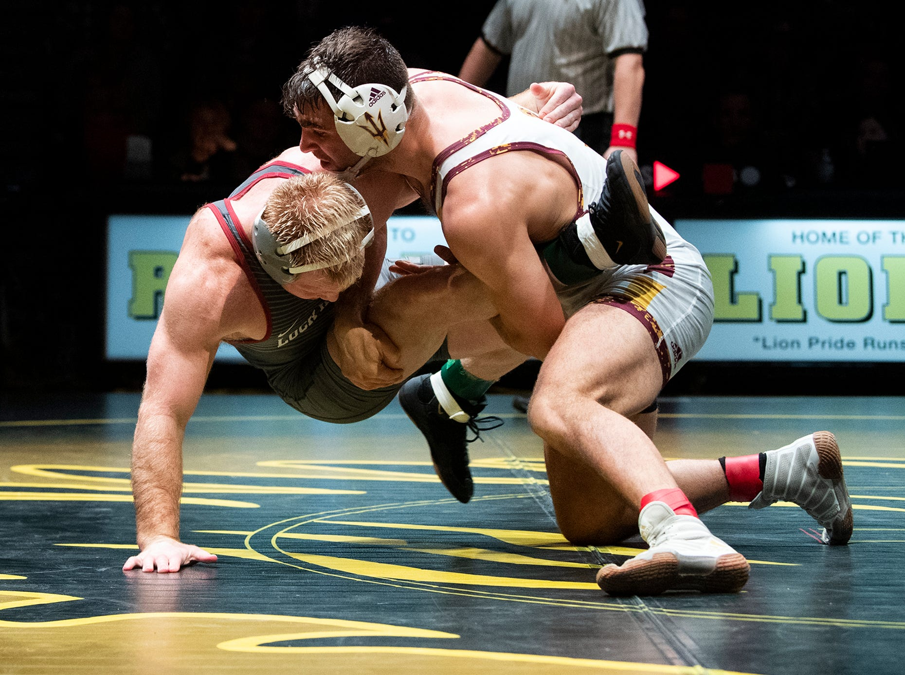 Arizona State's Josh Shields, right, works to take down Lock Haven's Chance Marsteller during the 165-pound bout at Red Lion's Fitzkee Athletic Center on Friday, Jan. 25, 2019. Shields (No. 5) beat Marsteller (No. 4), 2-1, in a tiebreaker. No. 22 Lock Haven upset No. 12 Arizona State, 23-14, in the first ever 'Rumble in the Jungle.'