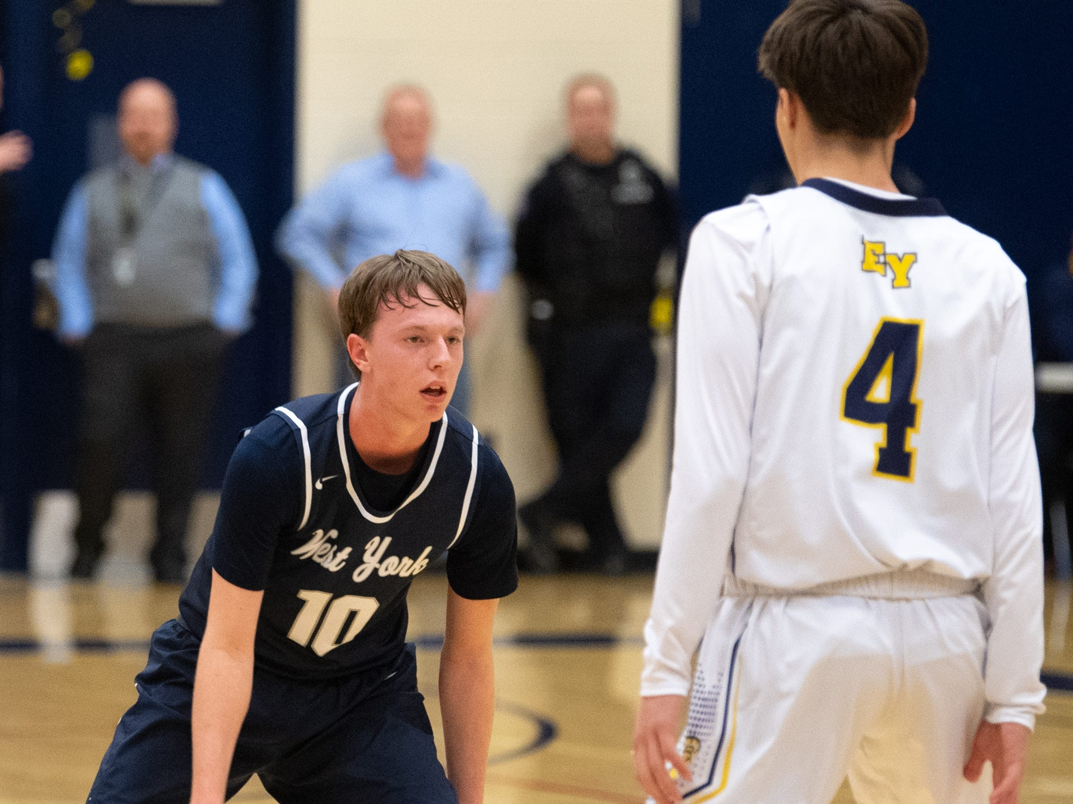 Corey Wise (10) sizes up Trevor Seitz (4) during the YAIAA boys' basketball game between Eastern York and West York, Friday, January 25, 2019 at Eastern York High School. The Golden Knights defeated the Bulldogs 59 to 55.