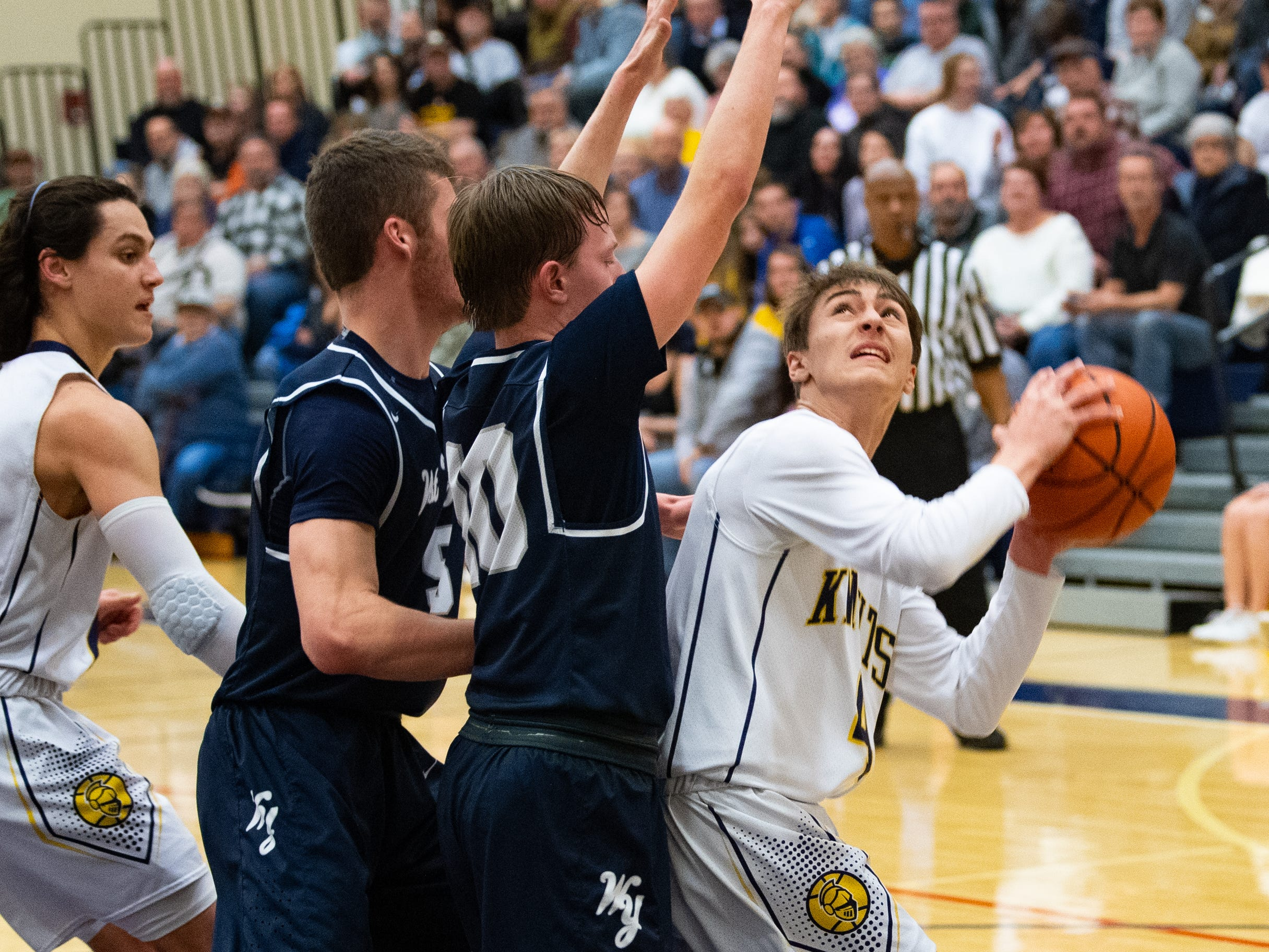 Trevor Seitz (4) looks to get a shot off during the YAIAA boys' basketball game between Eastern York and West York, Friday, January 25, 2019 at Eastern York High School. The Golden Knights defeated the Bulldogs 59 to 55.