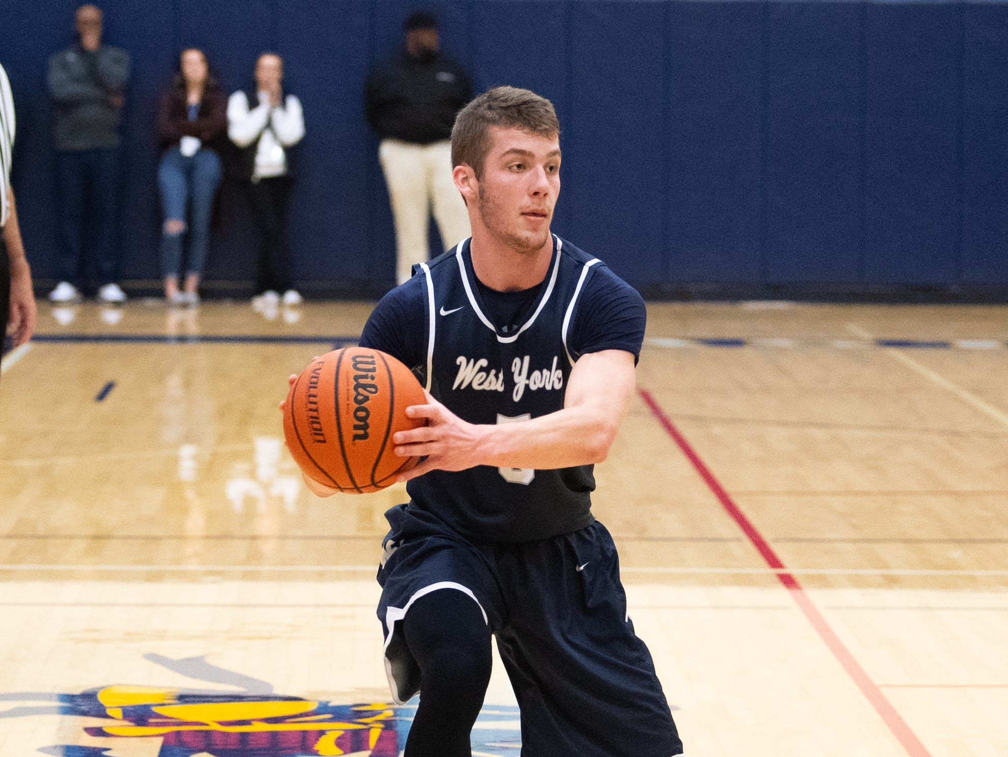 Andrew LaManna (5) prepares to pass during the YAIAA boys' basketball game between Eastern York and West York, Friday, January 25, 2019. The Golden Knights defeated the Bulldogs 59 to 55.