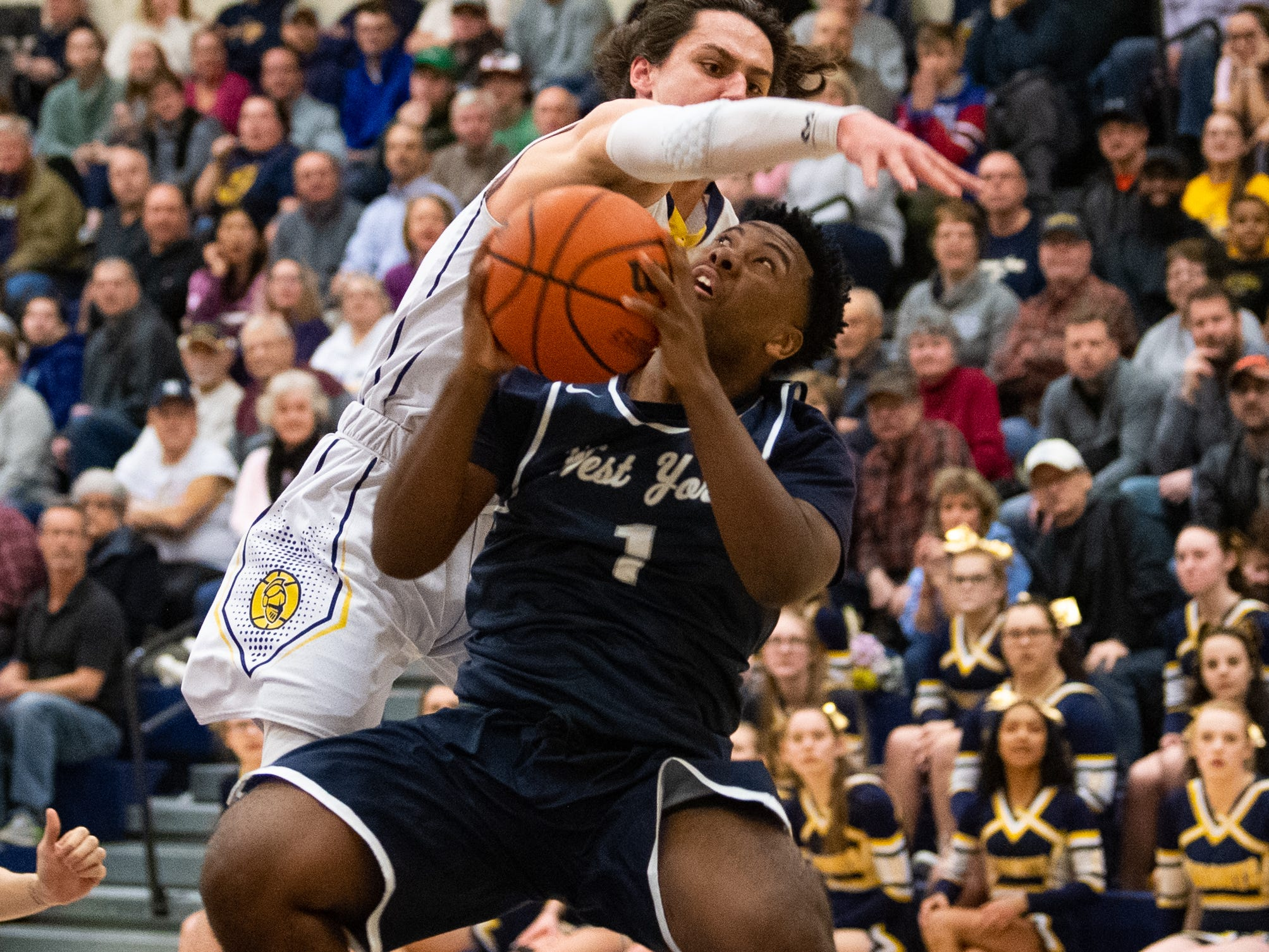 Kelvin Matthews (1) tries to get a shot off during the YAIAA boys' basketball game between Eastern York and West York, Friday, January 25, 2019. The Golden Knights defeated the Bulldogs 59 to 55.