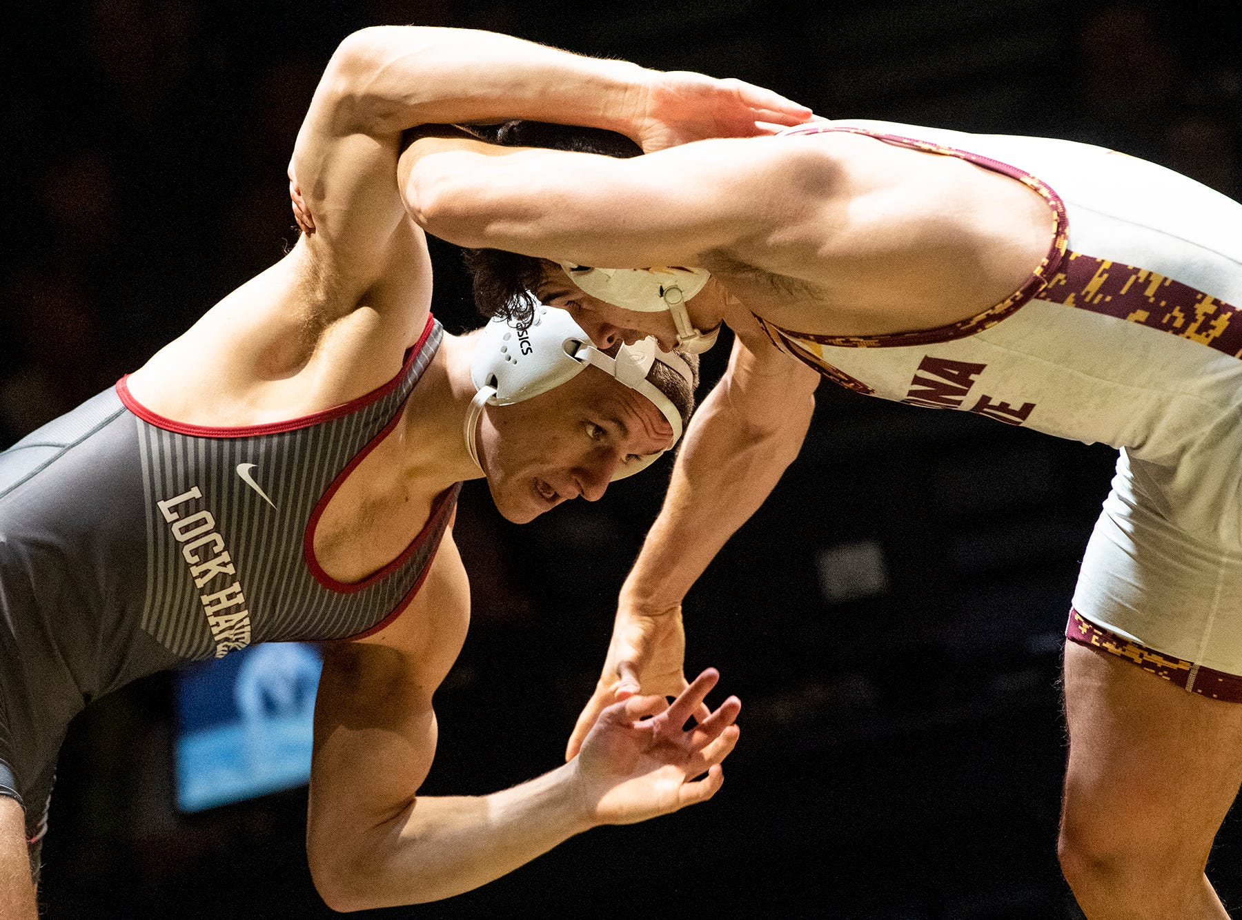 Lock Haven's Alex Klucker, left, wrestles with Arizona State's Christian Pagdilao (No. 15) during the 157-pound bout at Red Lion's Fitzkee Athletic Center on Friday, Jan. 25, 2019. Pagdilao beat Klucker, 10-4. No. 22 Lock Haven upset No. 12 Arizona State, 23-14, in the first ever 'Rumble in the Jungle.'