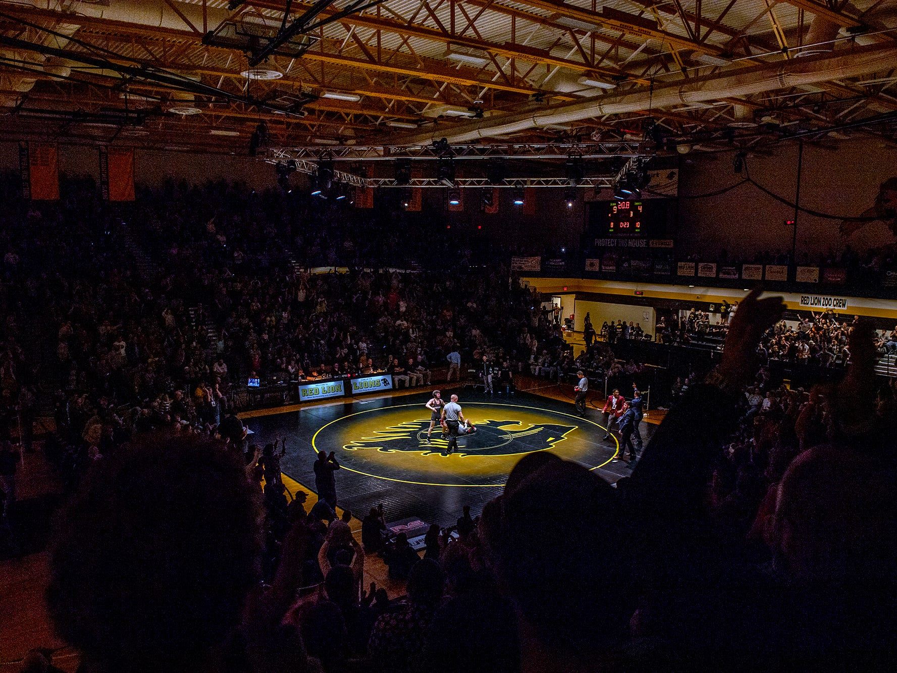 Fans erupt as Lock Haven's Luke Werner celebrates after pinning Arizona State's Brandon Courtney at Red Lion's Fitzkee Athletic Center on Friday, Jan. 25, 2019. The pin helped Werner's No. 22 Lock Haven Bald Eagles upset No. 12 Arizona State, 23-14, in the first ever 'Rumble in the Jungle.'