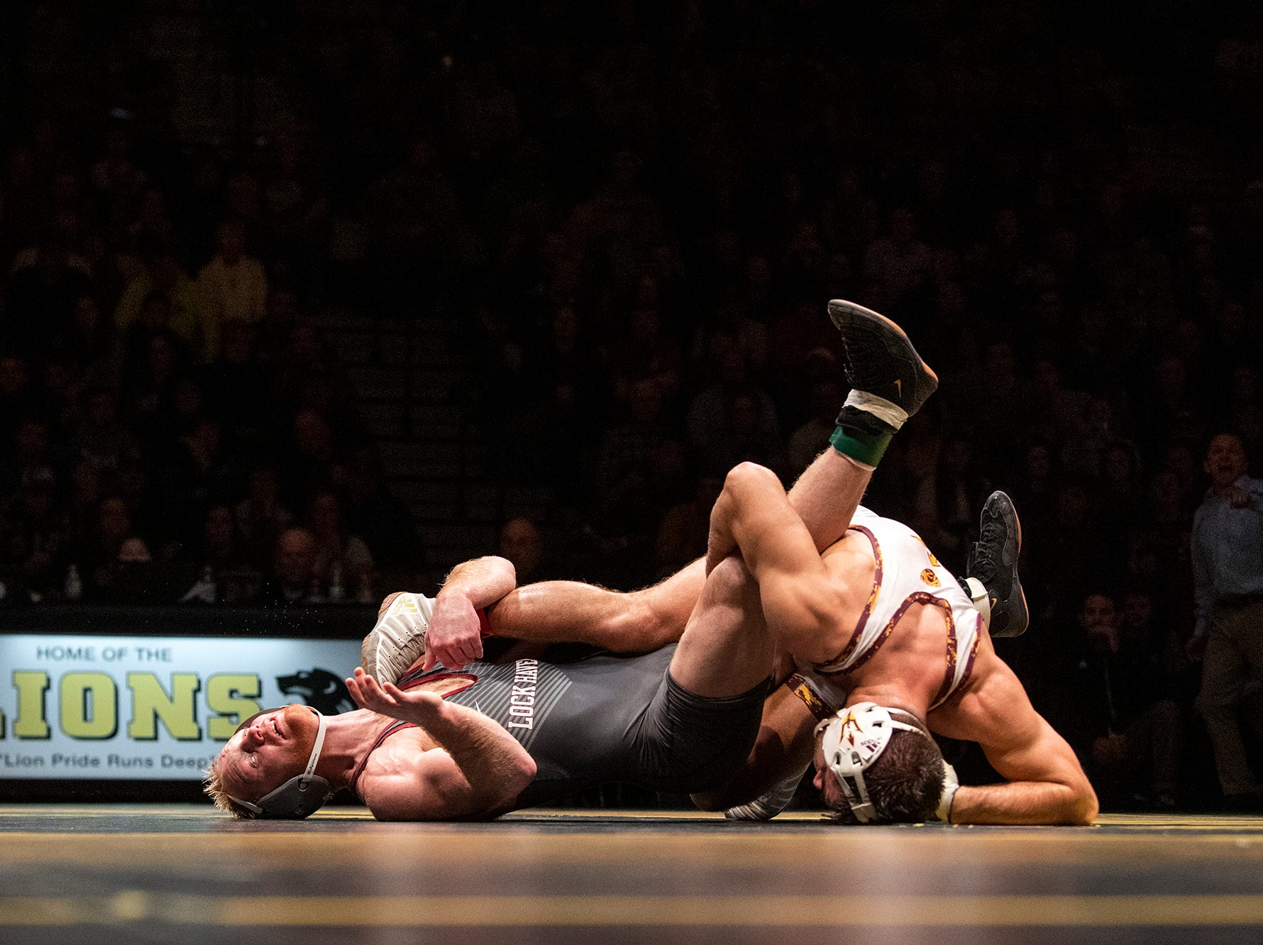 Arizona State's Josh Shields, right, works to turn Lock Haven's Chance Marsteller to his back during the 165-pound bout at Red Lion's Fitzkee Athletic Center on Friday, Jan. 25, 2019. Shields (No. 5) beat Marsteller (No. 4), 2-1, in a tiebreaker. No. 22 Lock Haven upset No. 12 Arizona State, 23-14, in the first ever 'Rumble in the Jungle.'