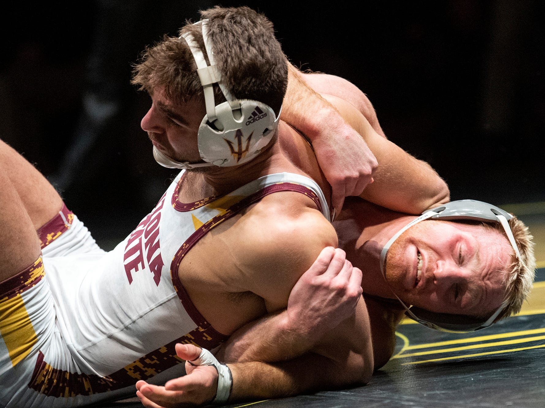 Lock Haven's Chance Marsteller, right, tries to takedown Arizona State's Josh Shields during the 165-pound bout at Red Lion's Fitzkee Athletic Center on Friday, Jan. 25, 2019. Shields (No. 5) beat Marsteller (No. 4), 2-1, in a tiebreaker. No. 22 Lock Haven upset No. 12 Arizona State, 23-14, in the first ever 'Rumble in the Jungle.'