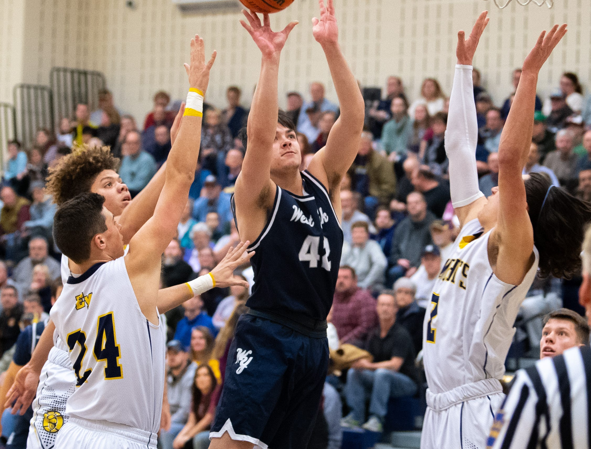Gabe Mummert (42) takes a contested layup during the YAIAA boys' basketball game between Eastern York and West York, Friday, January 25, 2019. The Golden Knights defeated the Bulldogs 59 to 55.