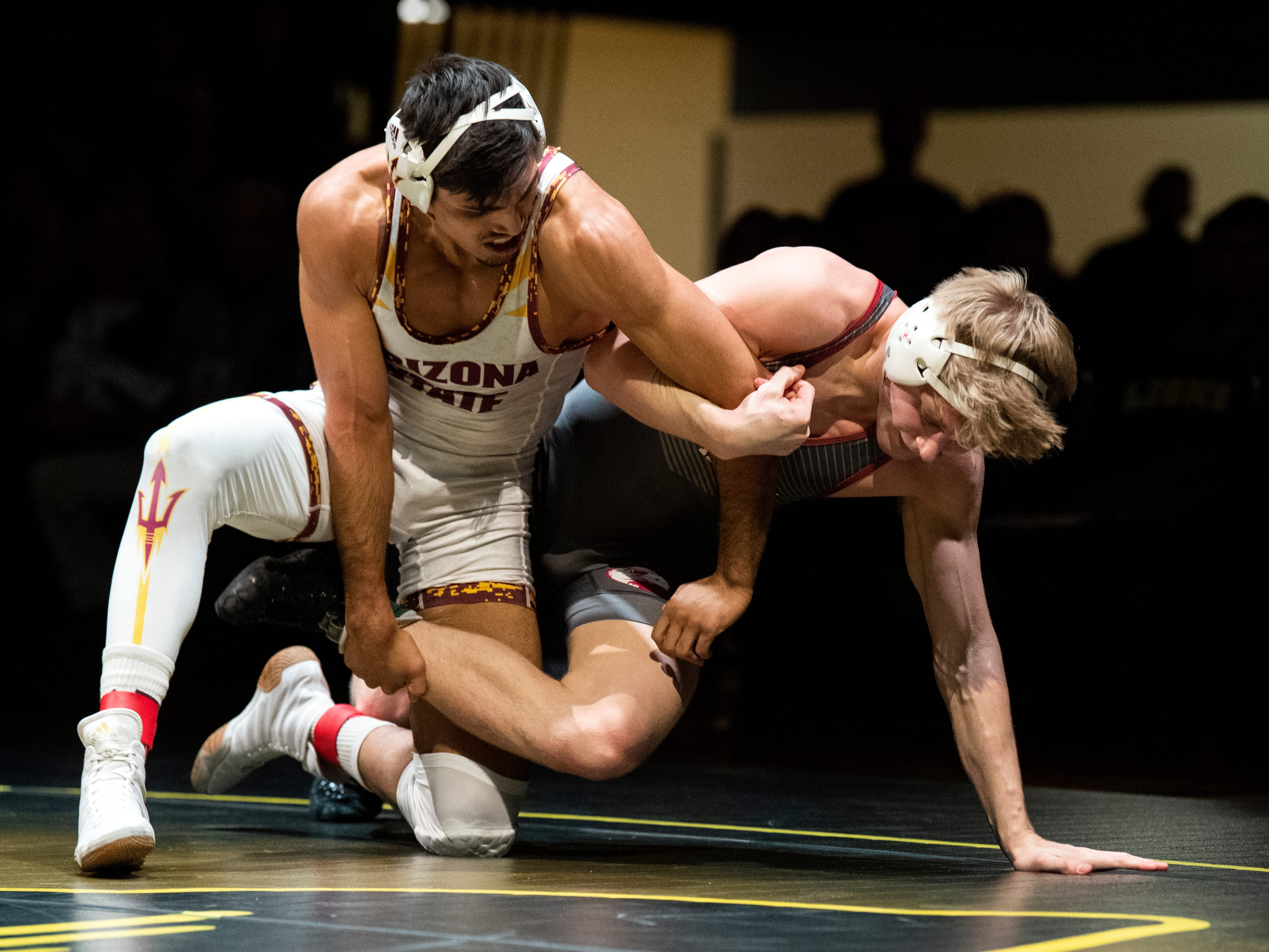Arizona State's Zahid Valencia, left, wrestles with Lock Haven's Jared Siegrist during the 174-pound bout at Red Lion's Fitzkee Athletic Center on Friday, Jan. 25, 2019. Valencia topped Siegrist, 14-4. No. 22 Lock Haven upset No. 12 Arizona State, 23-14, in the first ever 'Rumble in the Jungle.'