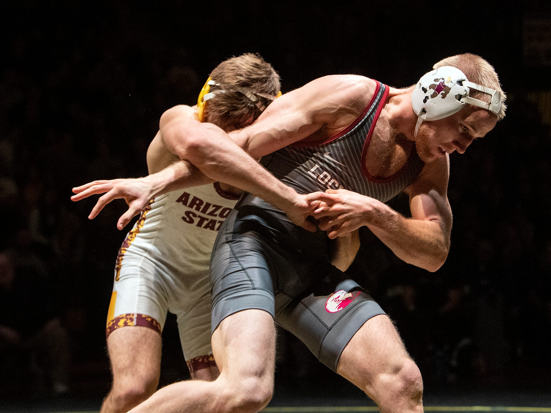 Lock Haven's D.J. Fehlman, right, works to escape Arizona State's Josh Kramer during the 133-pound bout at Red Lion's Fitzkee Athletic Center on Friday, Jan. 25, 2019. Fehlman beat Kramer 6-4 as No. 22 Lock Haven upset No. 12 Arizona State, 23-14, in the first ever 'Rumble in the Jungle.'