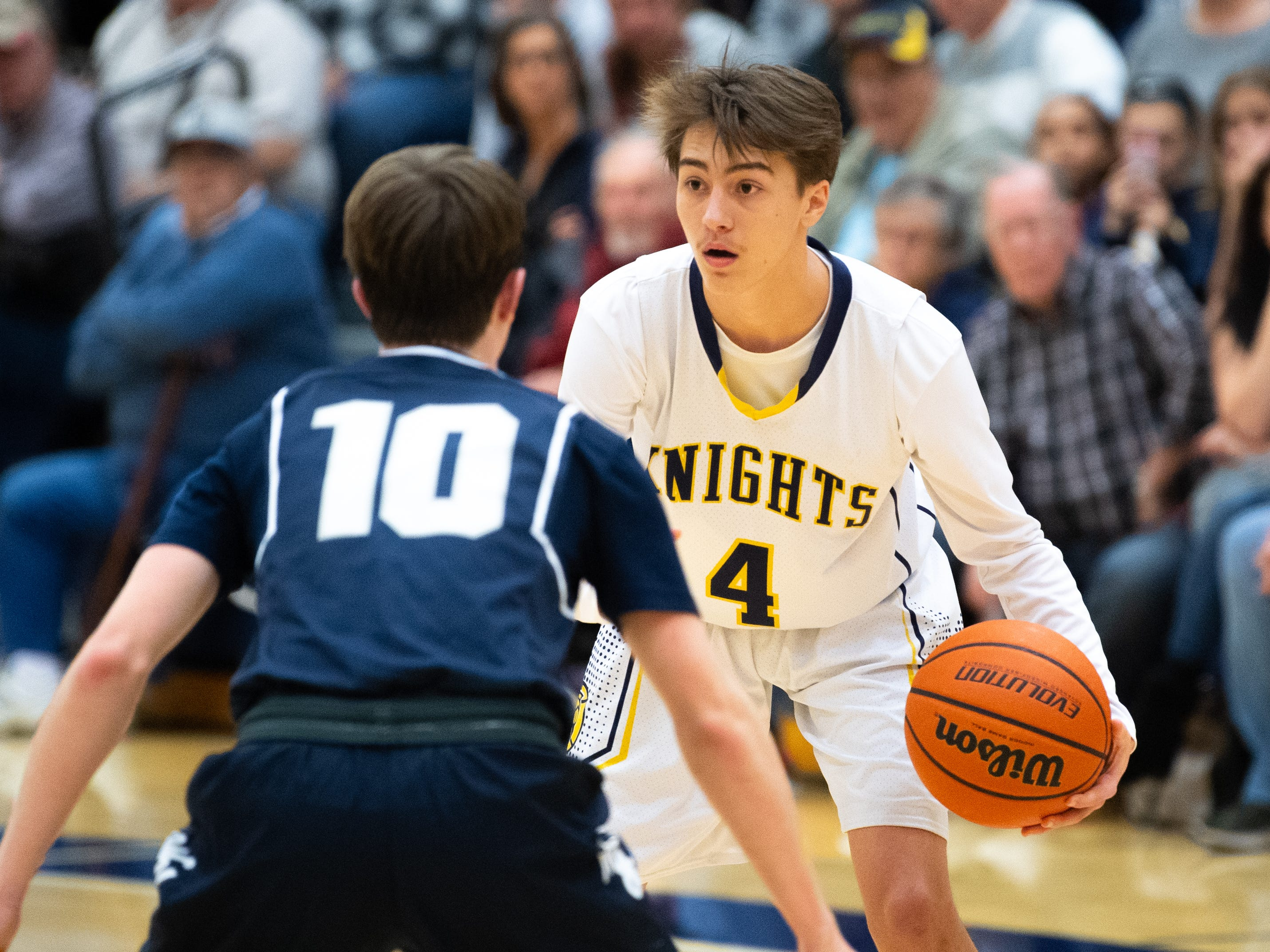 Trevor Seitz (4) scans the floor during the YAIAA boys' basketball game between Eastern York and West York, Friday, January 25, 2019 at Eastern York High School. The Golden Knights defeated the Bulldogs 59 to 55.
