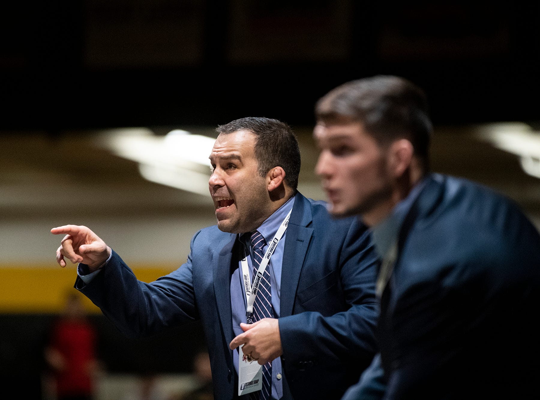 Lock Haven head coach Scott Moore yells out to a Bald Eagle wrestler at Red Lion's Fitzkee Athletic Center on Friday, Jan. 25, 2019. No. 22 Lock Haven upset No. 12 Arizona State, 23-14, in the first ever 'Rumble in the Jungle.'