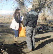 Case Manager Lucrecia Salguero talks with Wallace, a homeless man who lives in the Fernley area.