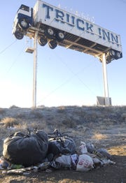 Garbage piles up near a homelss camp in Fernley.