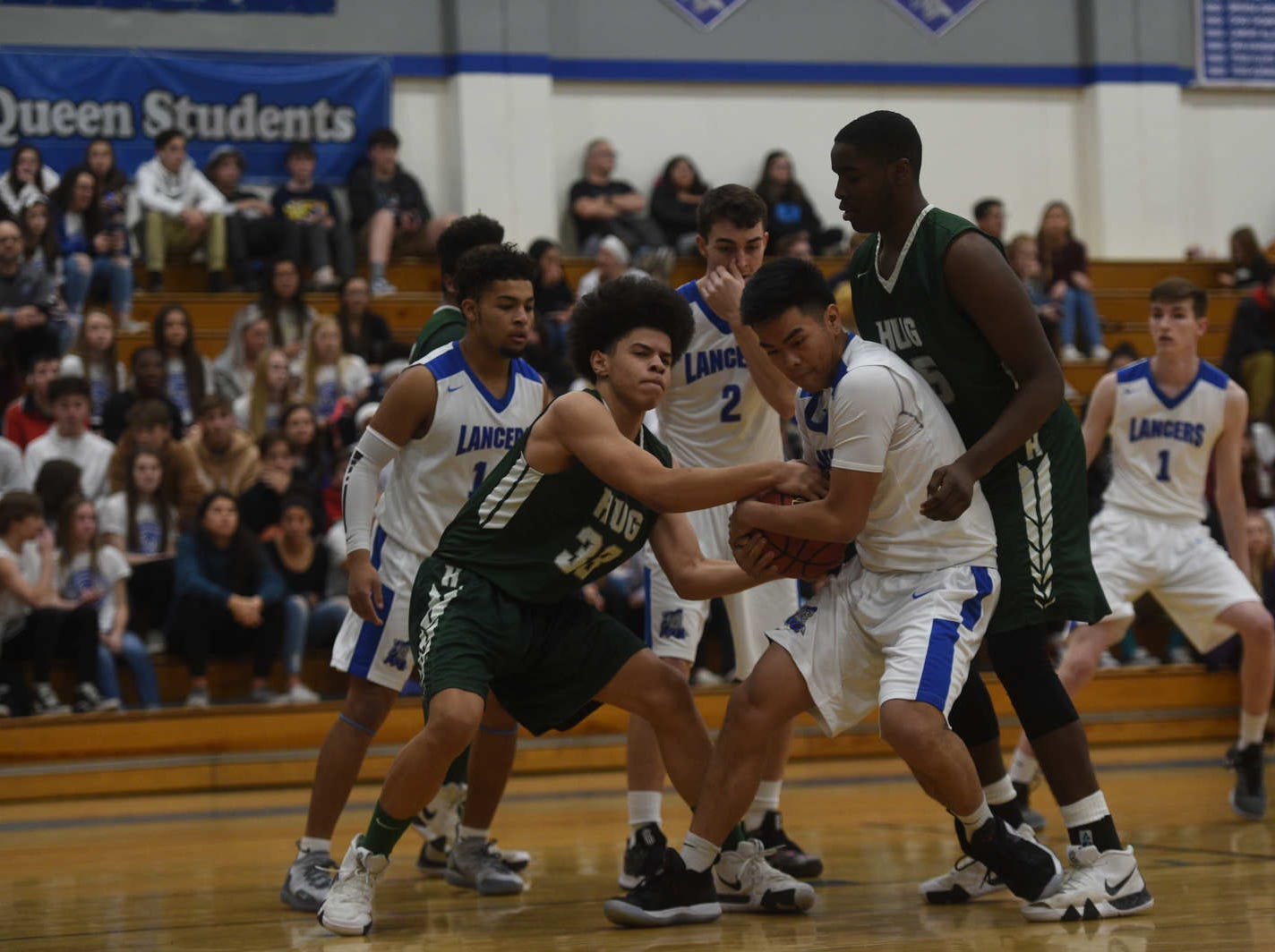 Hug takes on McQueen during their basketball game at McQueen on Jan. 25, 2019.
