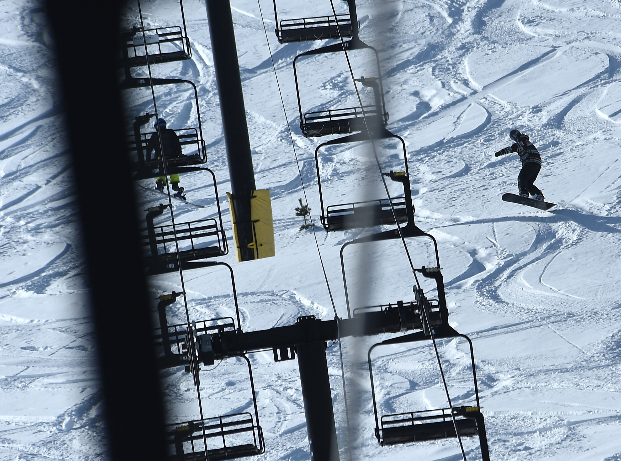 A snowboarder catches some air during opening day for the Sky Tavern Jr. Ski Program near Reno on Jan. 26, 2019.
