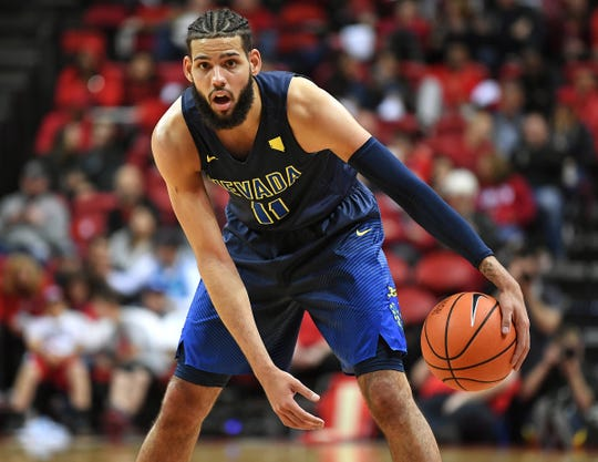 Nevada forward Cody Martin dribbles the ball during the second half against the UNLV Runnin' Rebels at Thomas & Mack Center last season.