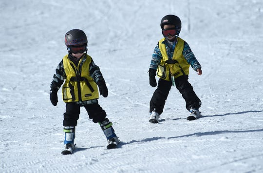 New skiers make their way down an easy slope during opening day for the Sky Tavern Jr. Ski Program near Reno on Jan. 26, 2019.