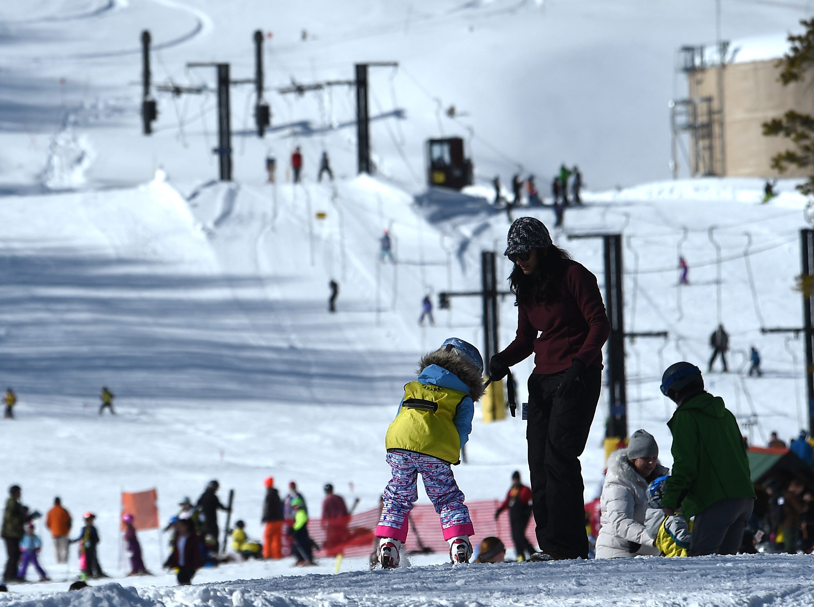 A new skier gets some help during opening day for the Sky Tavern Jr. Ski Program near Reno on Jan. 26, 2019.