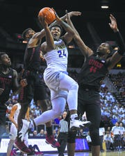 Jordan Caroline shoots against UNLV last season.