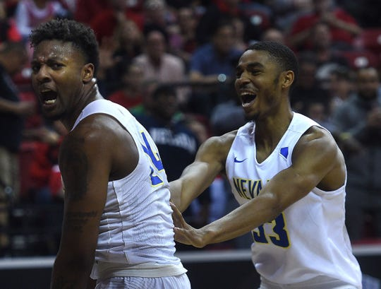 Nevada's Jordan Caroline (24) and Josh Hall (33) react after scoring while taking on UNLV during the Mountain West Men's Basketball Championships at the Thomas & Mack Center in Las Vegas on March 8, 2018.