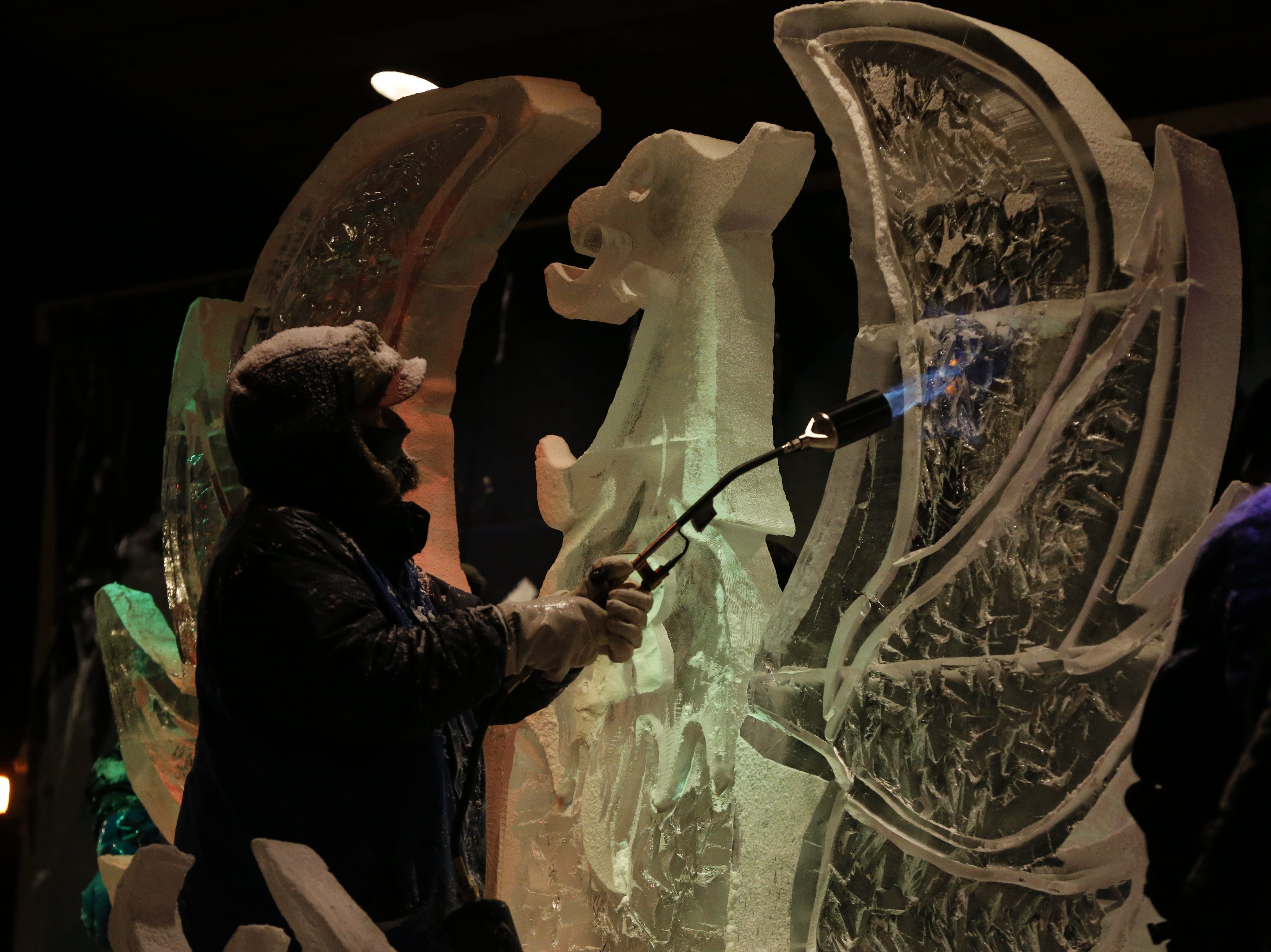 """A blowtorch provides the finishing touches on a phoenix sculpture created during the """"Big Reveal"""" on Friday night."""