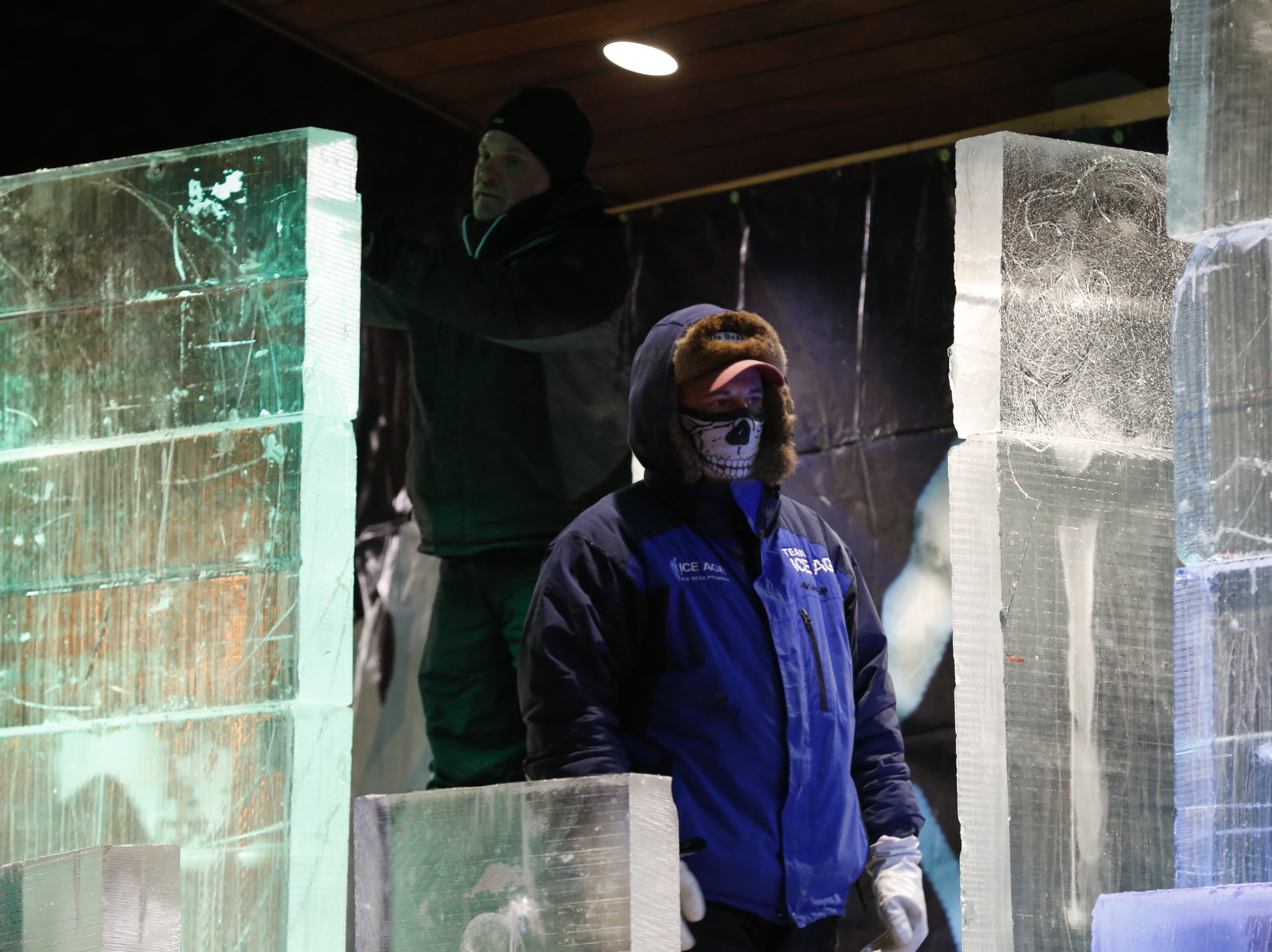 """Ice carvers prepare for Friday night's """"Big Reveal"""" event during the Meltdown Winter Ice Festival at Jack Elstro Plaza in Richmond."""