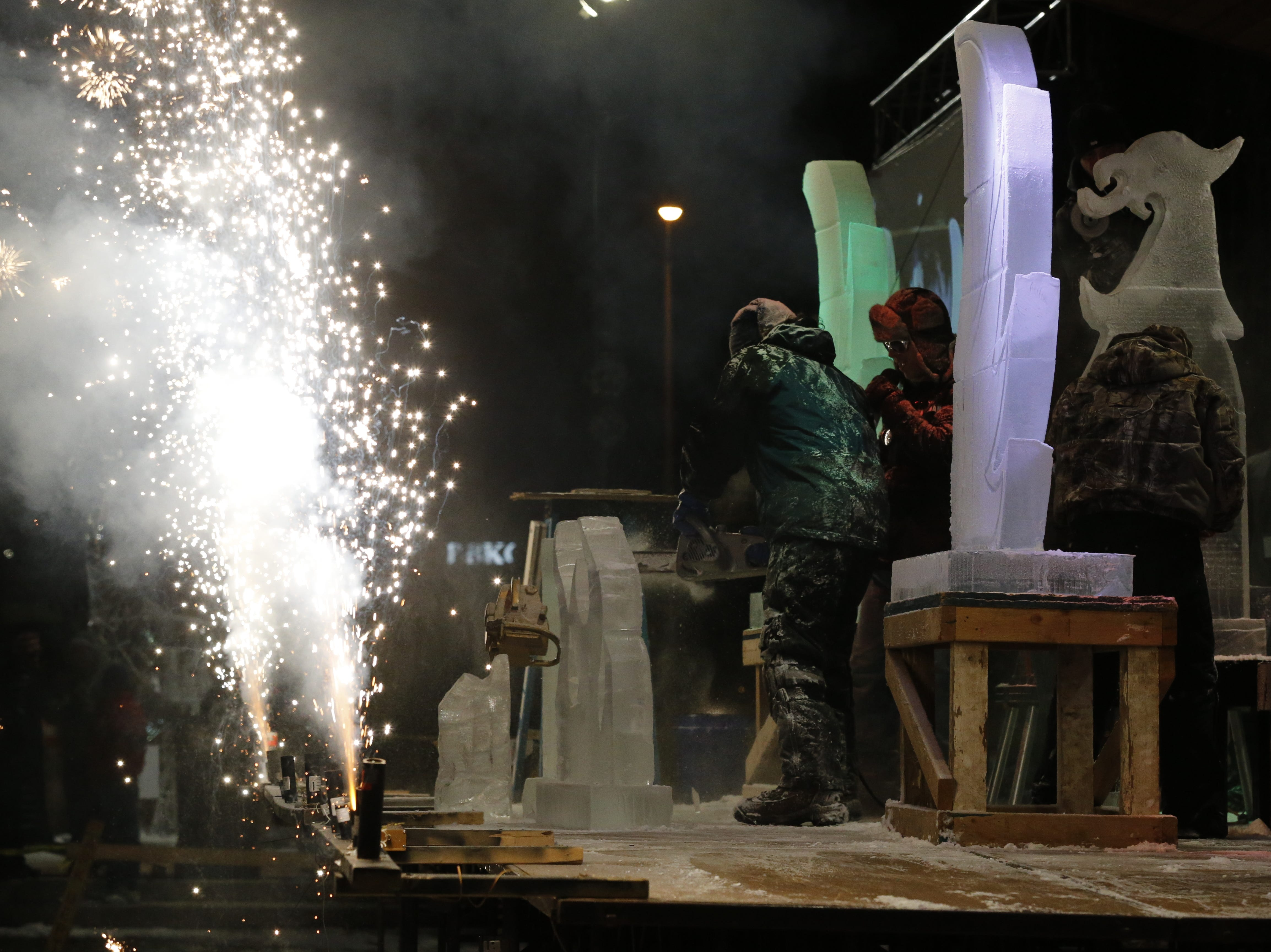 """There was plenty of ice and some fire in the form of fireworks during the """"Big Reveal"""" on Friday at the Meltdown Winter Ice Festival in Richmond."""