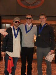Jonathon Lillis, left, Chris Lillis, center, and Nick Novak, the top three finishers at the United States Aerial Championships pose at a banquet in Lake Placid on Saturday evening.