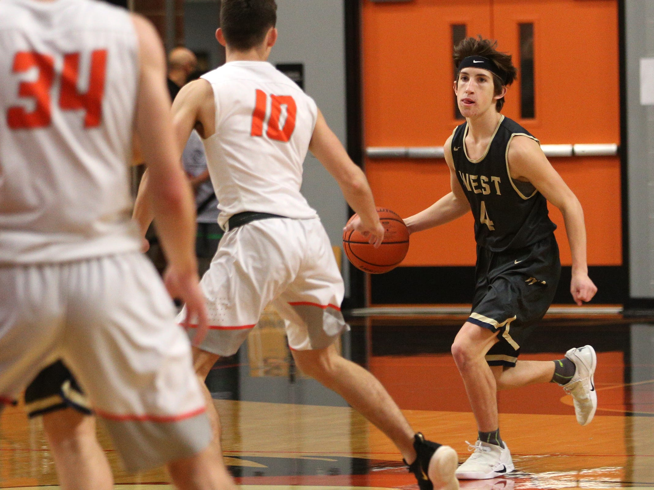 West Albany's Tanner Madsen (4) during the West Albany vs. Silverton High School boys basketball game in Silverton on Friday, Jan. 25, 2019.