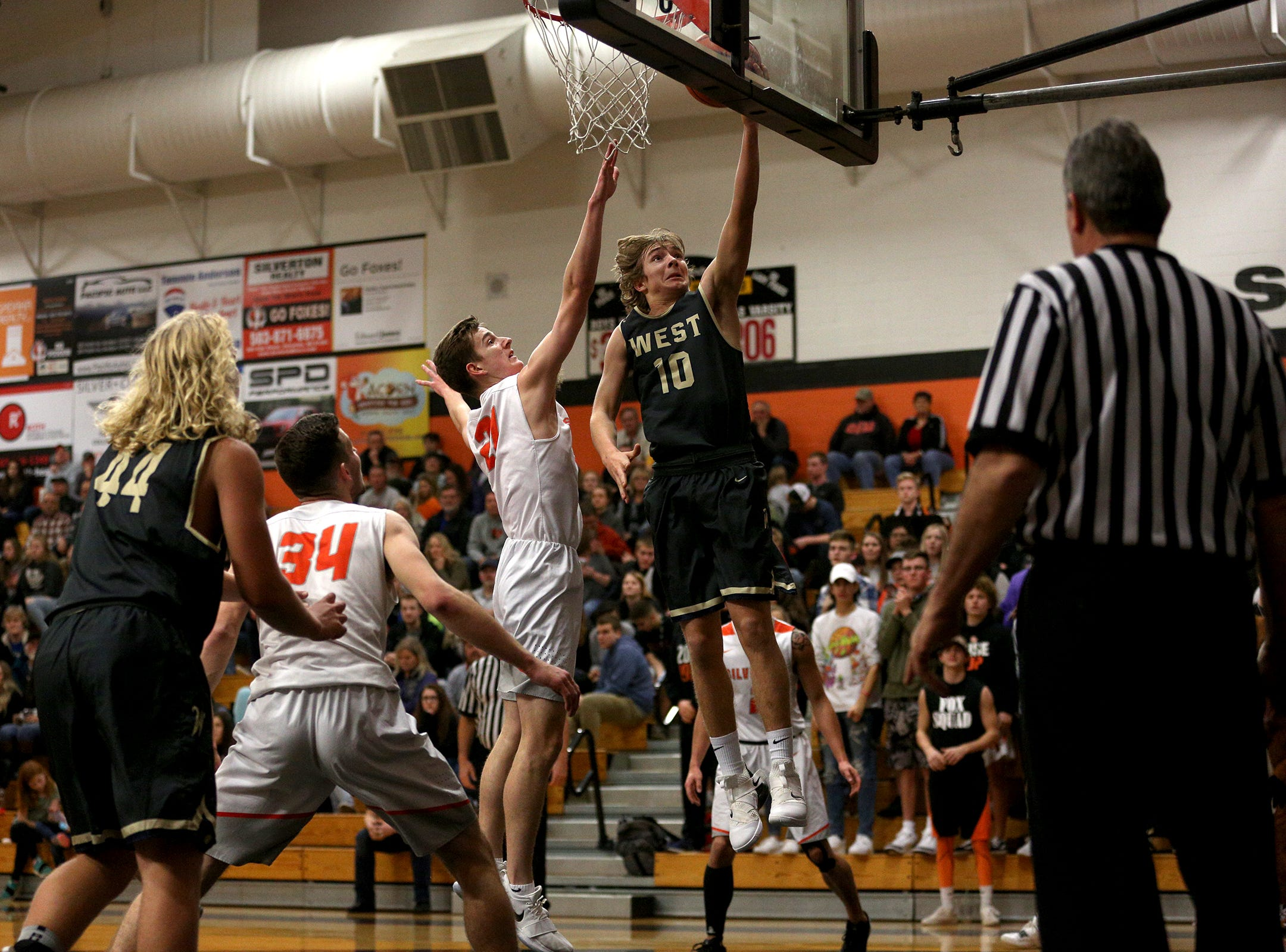 West Albany's Luke Killinger (10) goes up in the paint during the West Albany vs. Silverton High School boys basketball game in Silverton on Friday, Jan. 25, 2019. Killinger finished with 19 points.