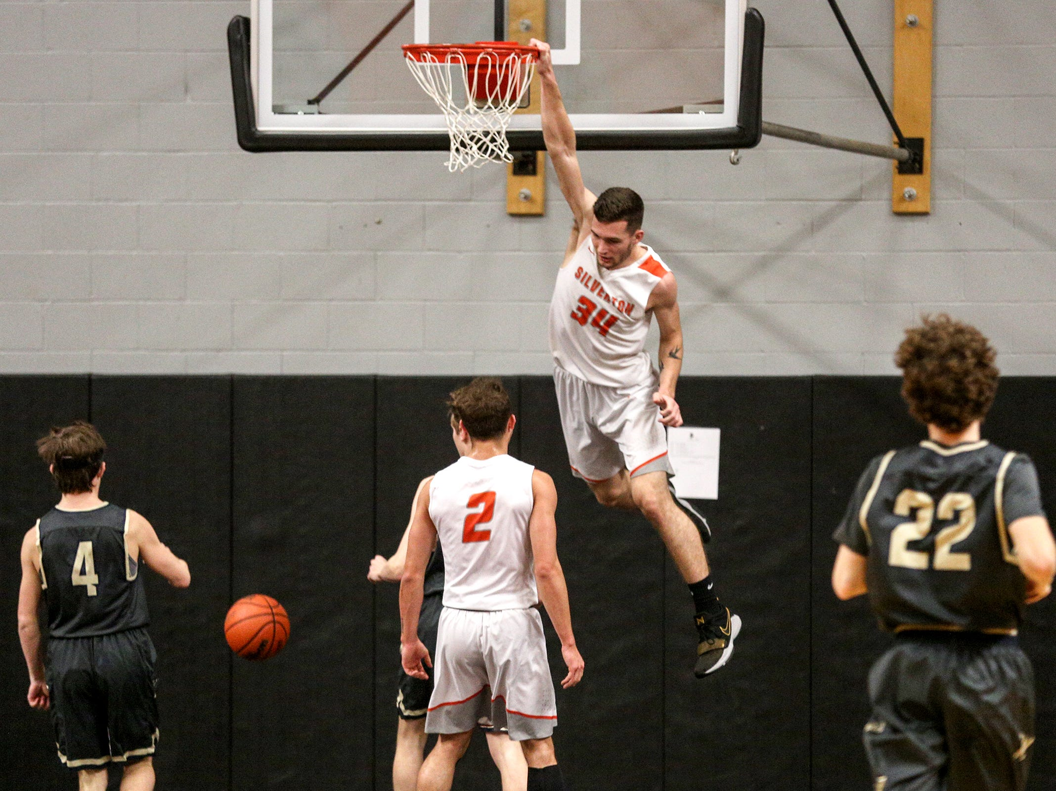 Silverton's Levi Nielsen (34) dunks during the West Albany vs. Silverton High School boys basketball game in Silverton on Friday, Jan. 25, 2019.