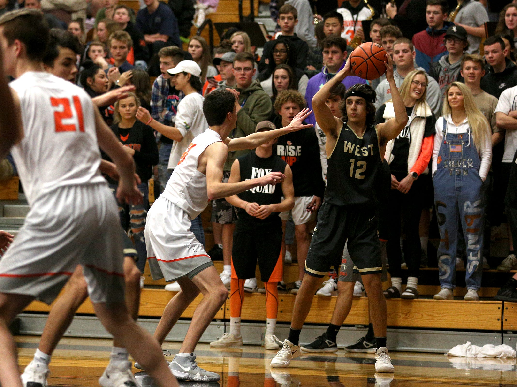 West Albany's Channon Schuerger (12) looks to make a pass during the West Albany vs. Silverton High School boys basketball game in Silverton on Friday, Jan. 25, 2019.