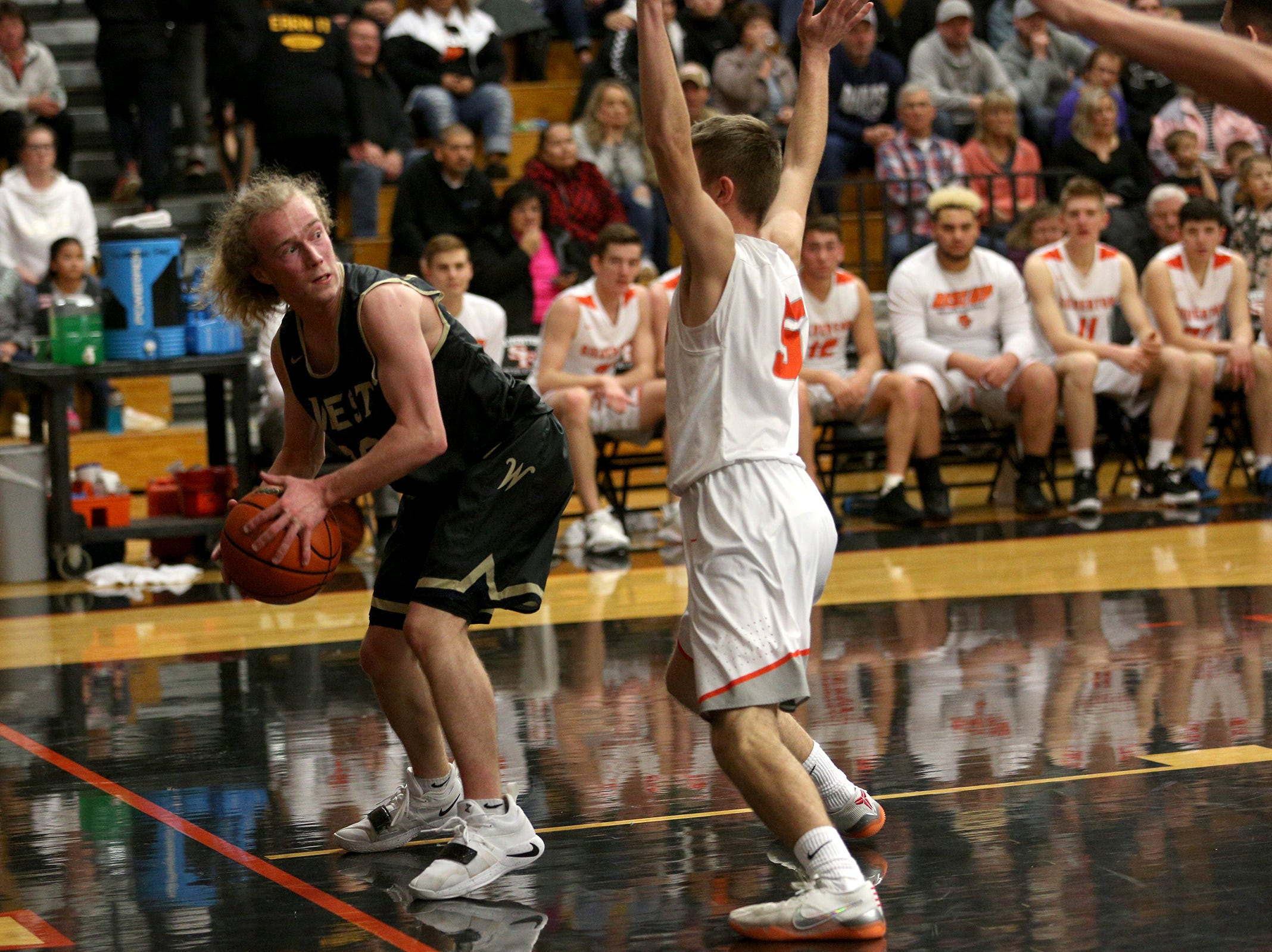 West Albany's Austin Stanaway (20) attempts to get around Silverton's defense during the West Albany vs. Silverton High School boys basketball game in Silverton on Friday, Jan. 25, 2019.