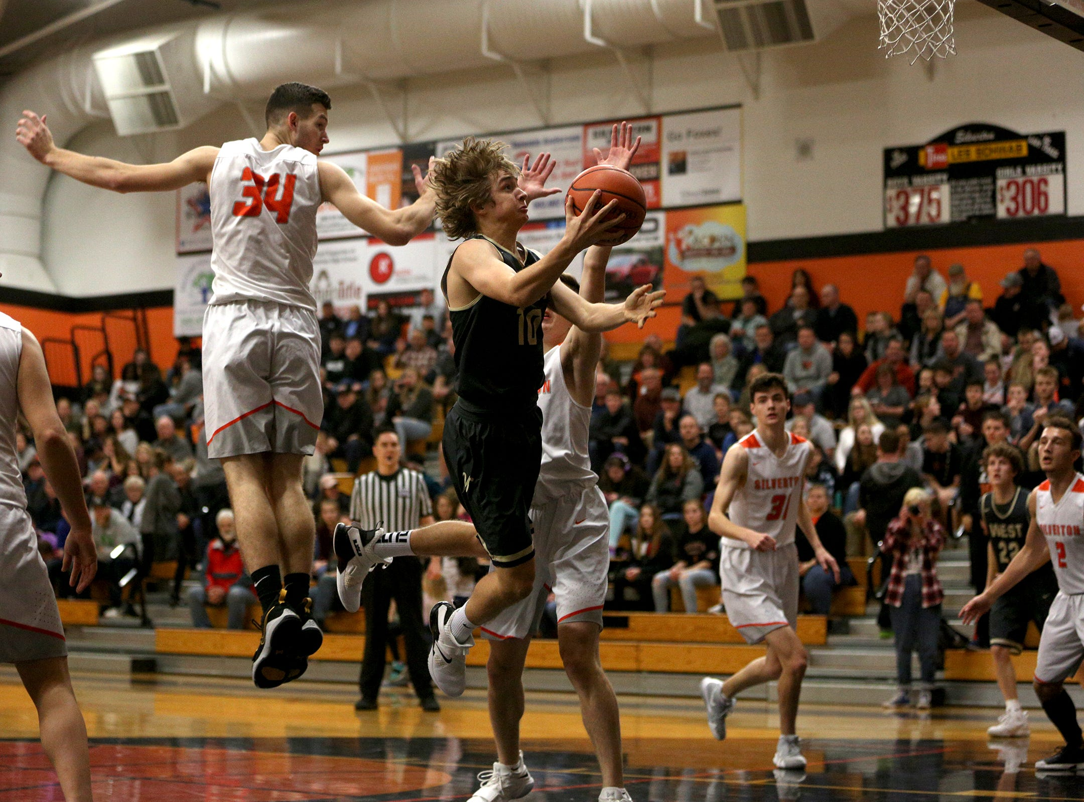 West Albany's Luke Killinger (10) goes up for a layup during the West Albany vs. Silverton High School boys basketball game in Silverton on Friday, Jan. 25, 2019. Killinger finished with 19 points.