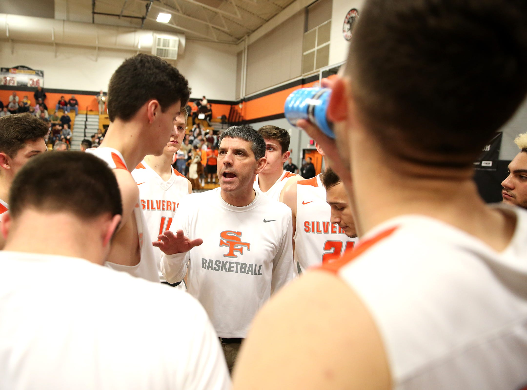 Silverton's head coach Jamie McCarty talks to his team during the West Albany vs. Silverton High School boys basketball game in Silverton on Friday, Jan. 25, 2019.