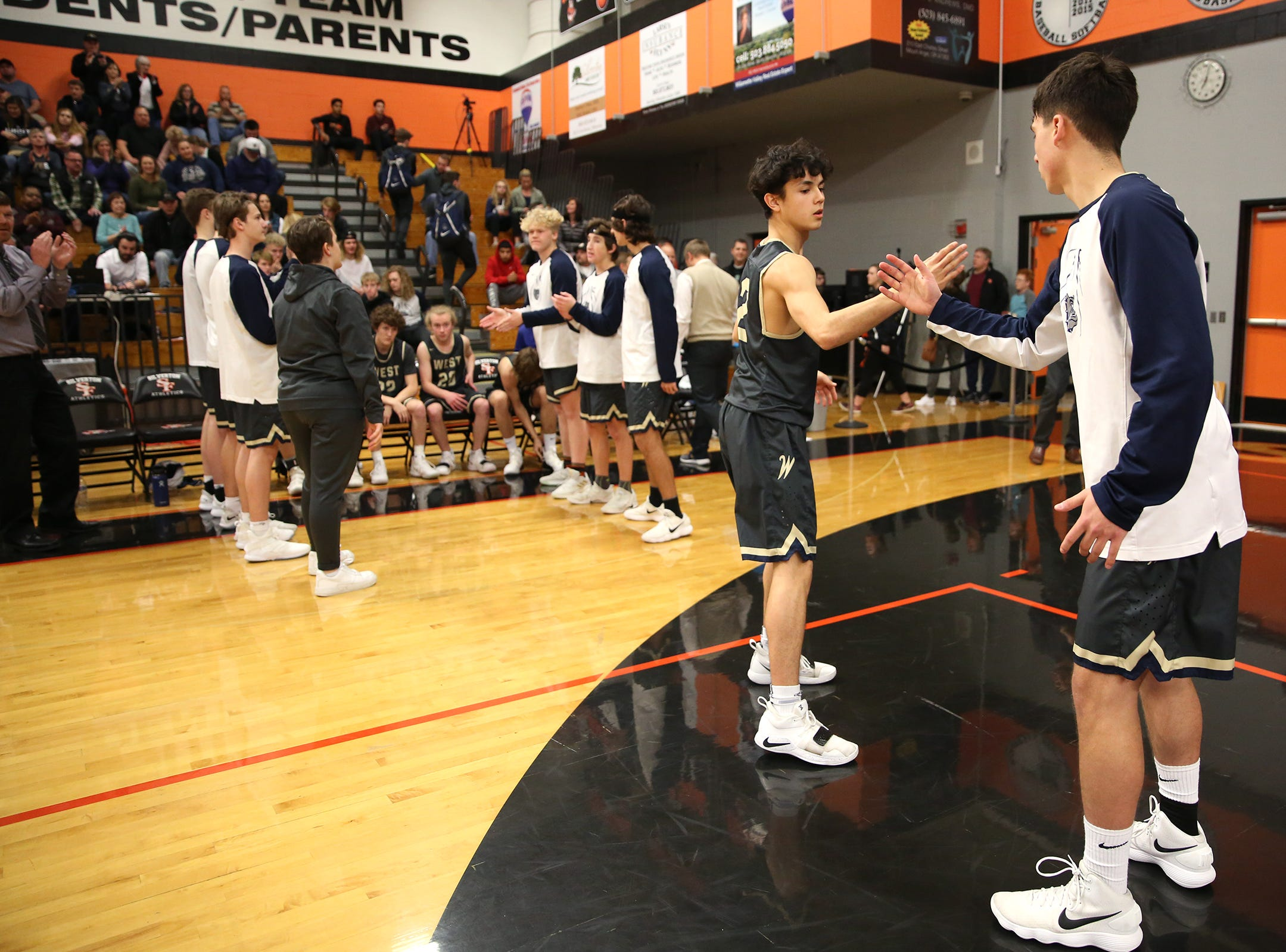 West Albany's Koby Ruiz (2) is introduced during the West Albany vs. Silverton High School boys basketball game in Silverton on Friday, Jan. 25, 2019.