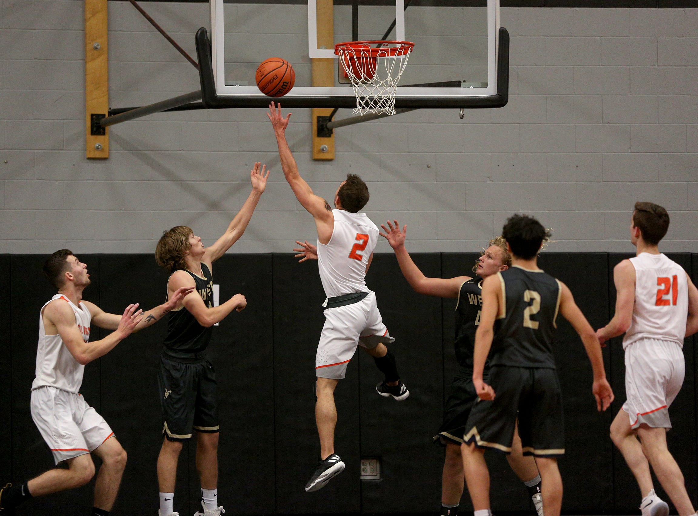 Silverton's Jonah Downey (2) goes up for a layup during the West Albany vs. Silverton High School boys basketball game in Silverton on Friday, Jan. 25, 2019.