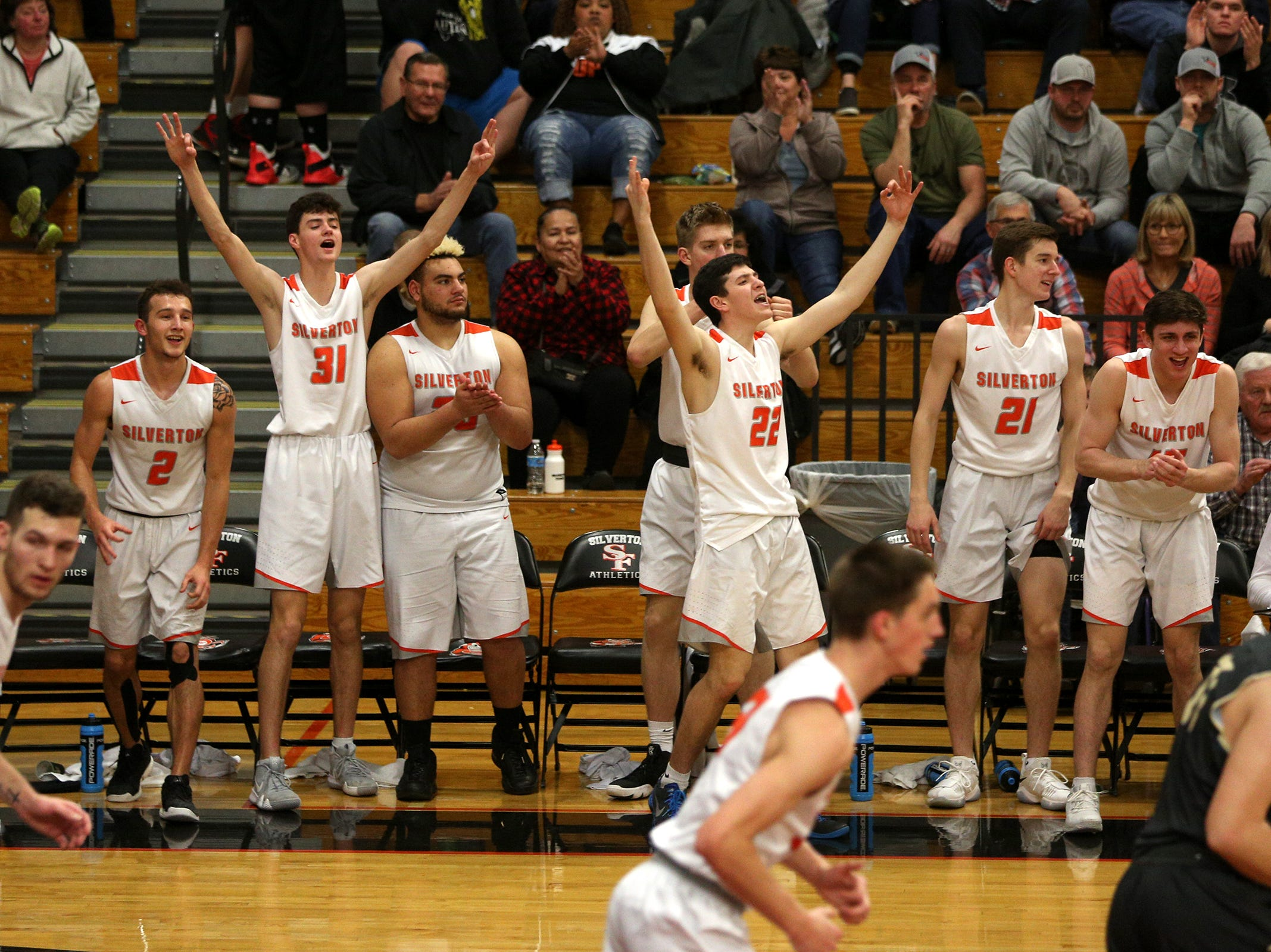 Silverton's bench celebrates during the West Albany vs. Silverton High School boys basketball game in Silverton on Friday, Jan. 25, 2019.