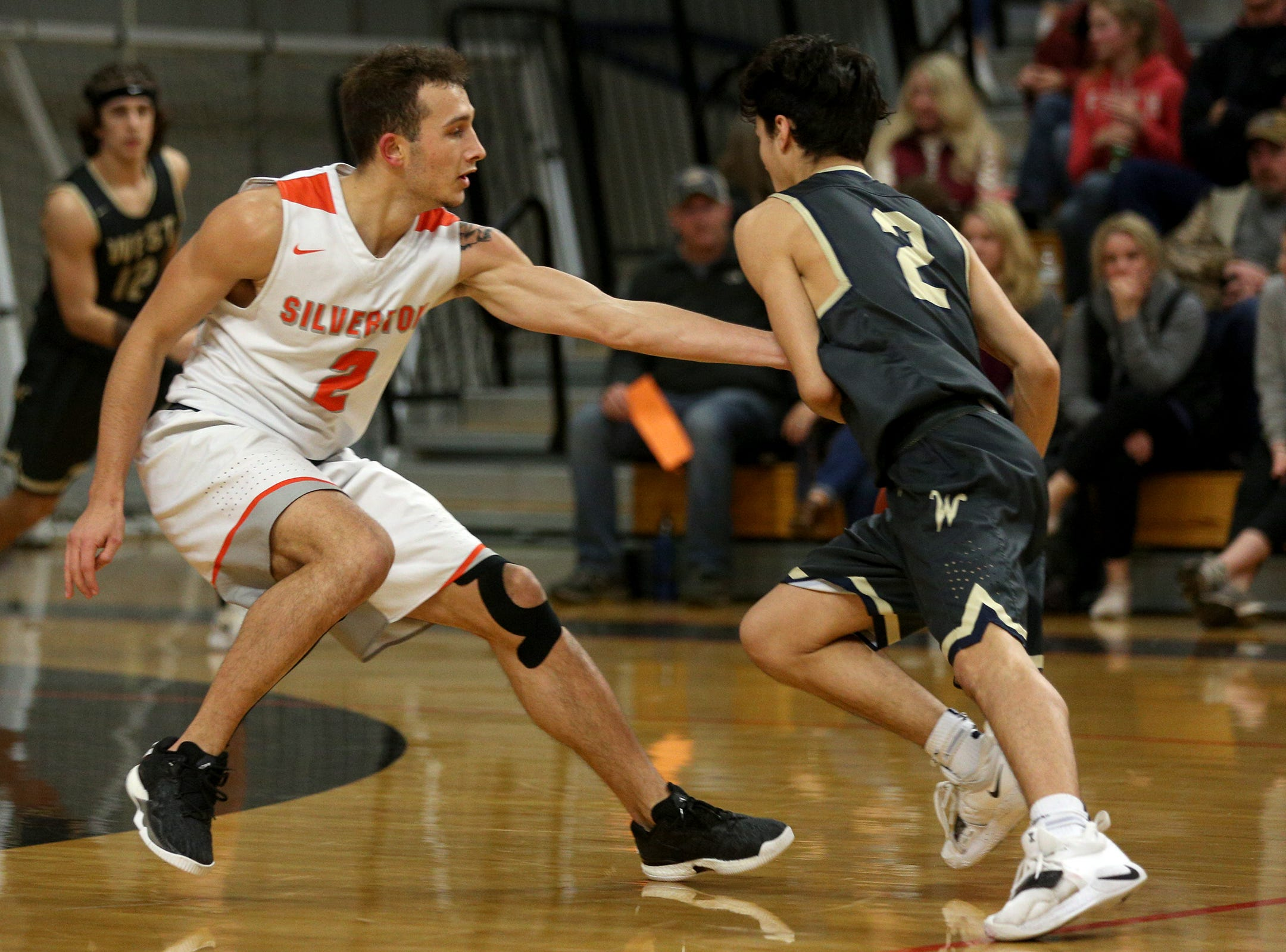Slverton's Jonah Downey (2) attempts a steal during the West Albany vs. Silverton High School boys basketball game in Silverton on Friday, Jan. 25, 2019.
