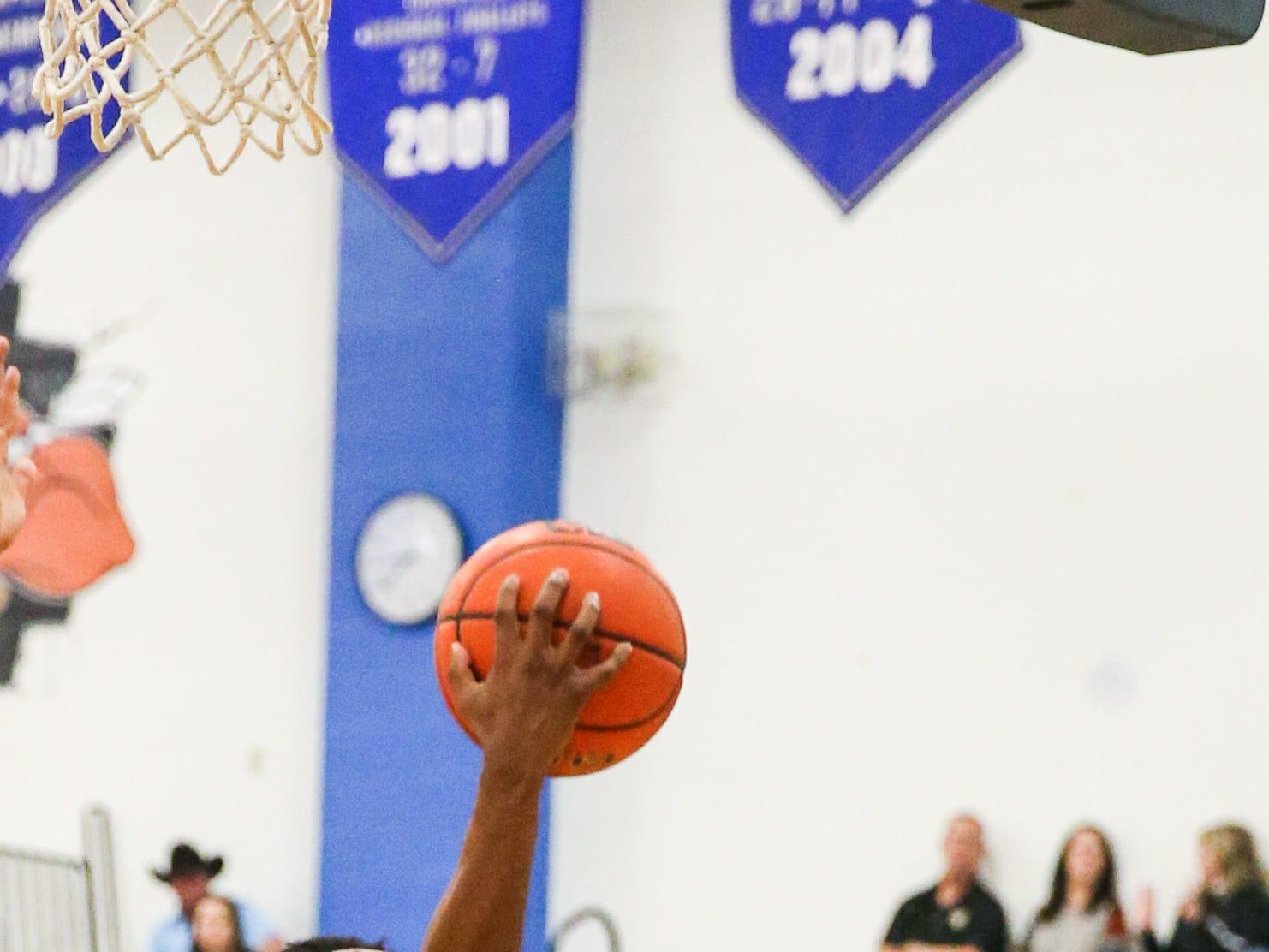 Lake View's Ahmad Daniels jumps to shoot as Big Spring player blocks Friday, Jan. 25, 2019, at Lake View gym.