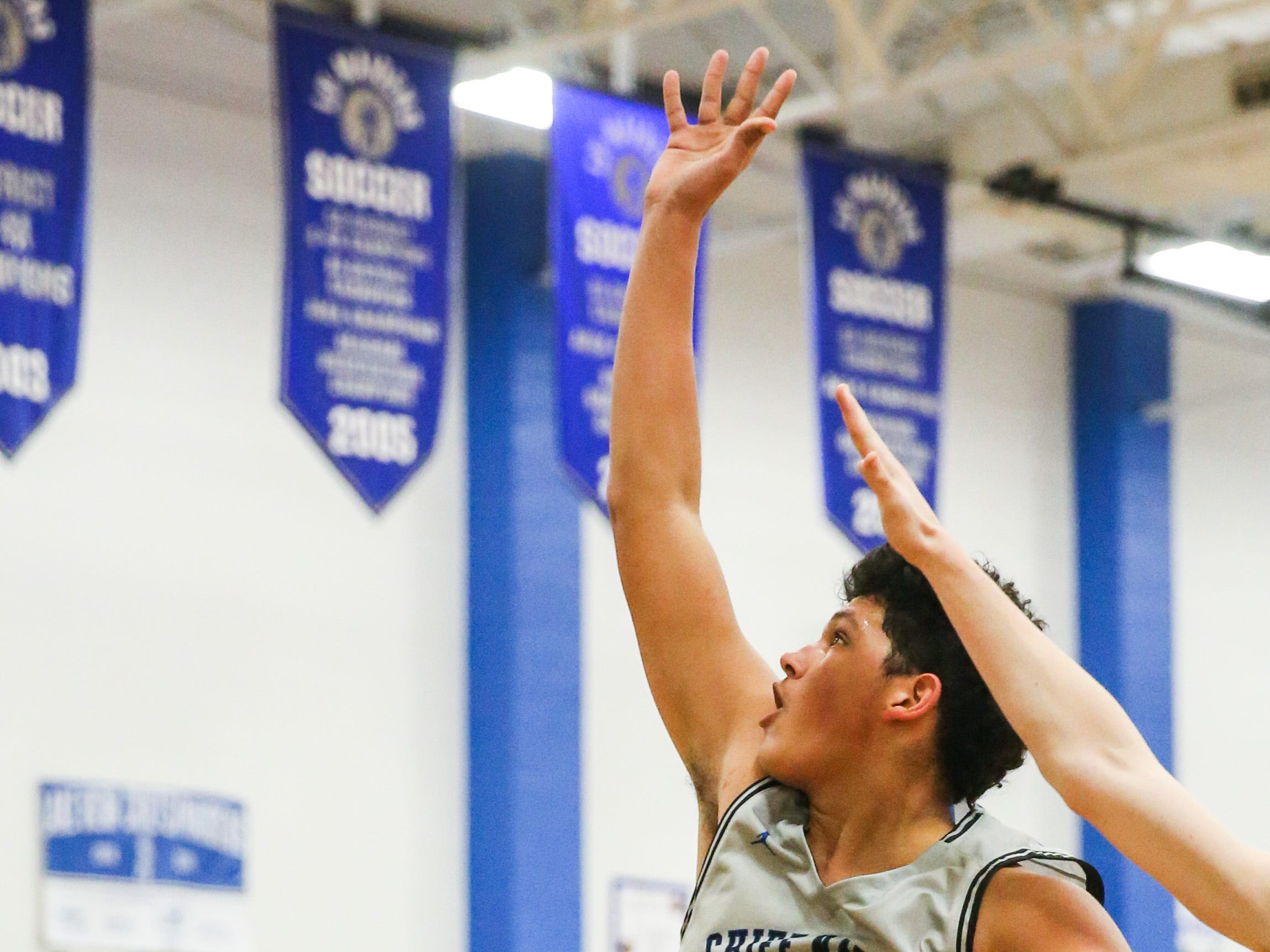 Lake View's Joseph Brooks jumps to shoot as Big Spring player blocks Friday, Jan. 25, 2019, at Lake View gym.