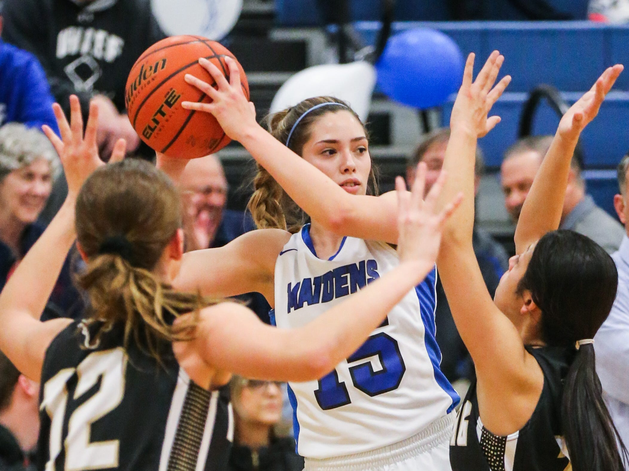 Lake View's Shae Gonzales looks to pass as Big Spring players surround Friday, Jan. 25, 2019, at Lake View gym.
