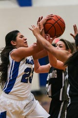 Lake View's Alaysia Capuchina fights for the rebound with Big Spring players Friday, Jan. 25, 2019, at Lake View gym.