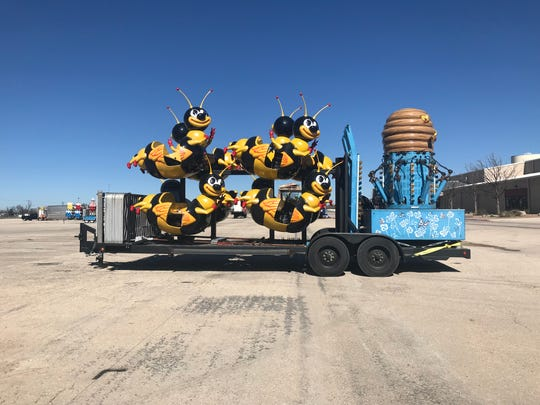 Friendly bees will have to wait until Feb. 1 to carry passengers, as the Sutliff and Stout Carnival sets up the Midway at the San Angelo Stock Show and Rodeo on Friday, Jan. 25, 2019.
