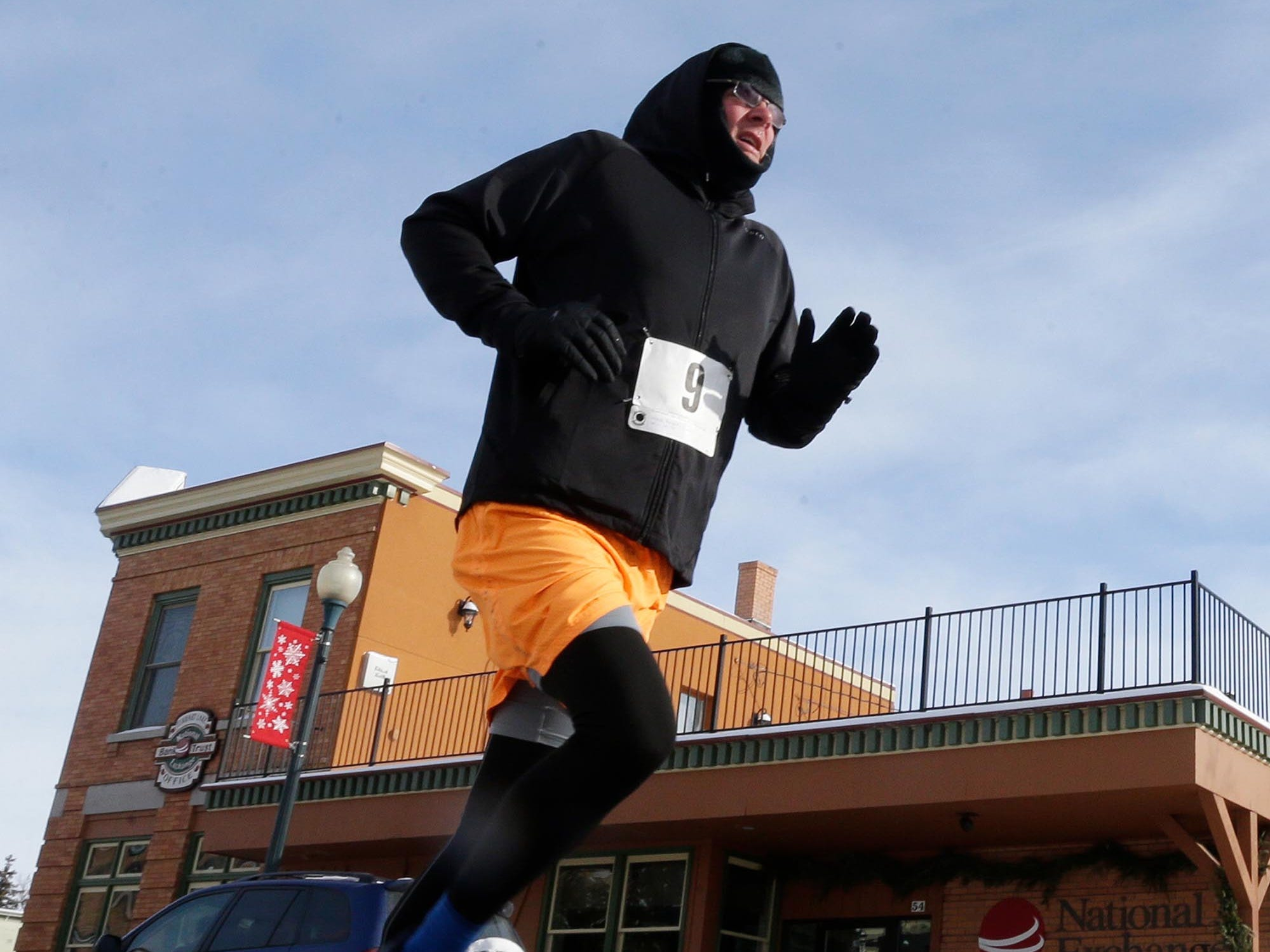 Mark Burgard (9) of Manitowoc runs the Schneelauf Run, Saturday, January 26, 2019, in Elkhart Lake, Wis. Burgard took first place with a time of 13:59 for the two-mile event.